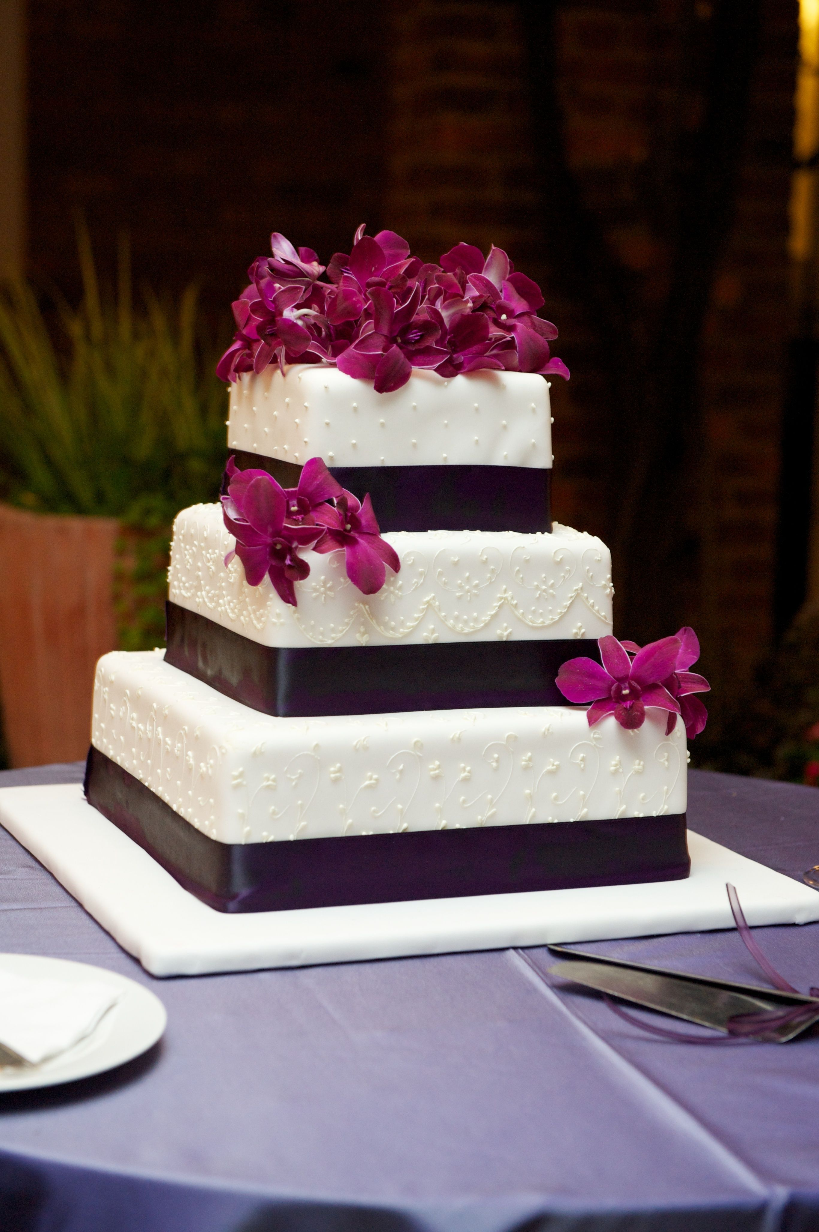 Purple orchid wedding cake Let Them Eat Cake