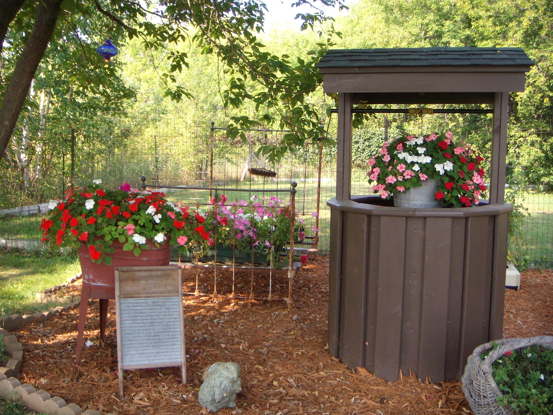 wishing well garden outdoor styles pinterest. Black Bedroom Furniture Sets. Home Design Ideas