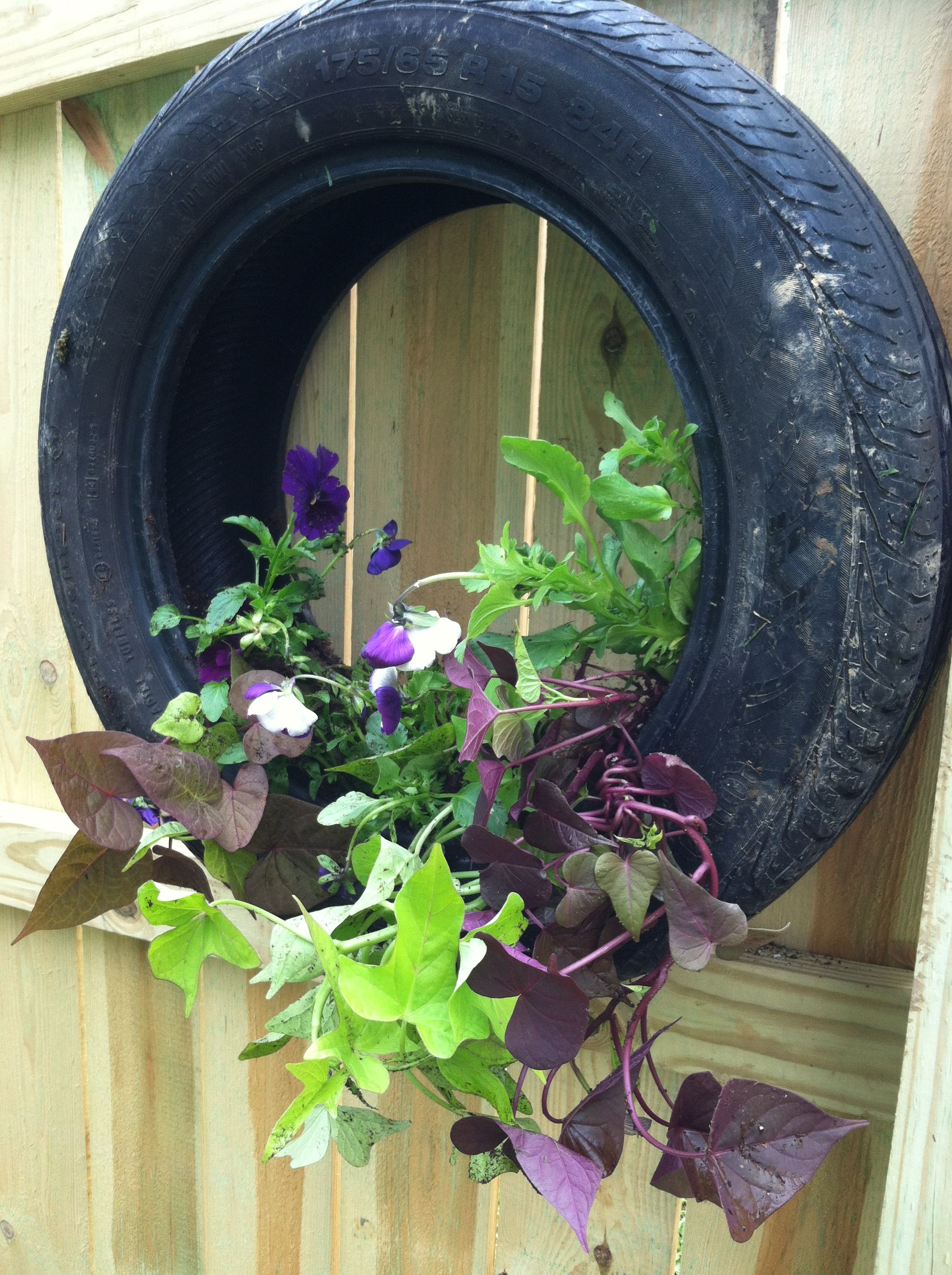 Old tire new planter upcycle old tires pinterest - Planters made from old tires ...