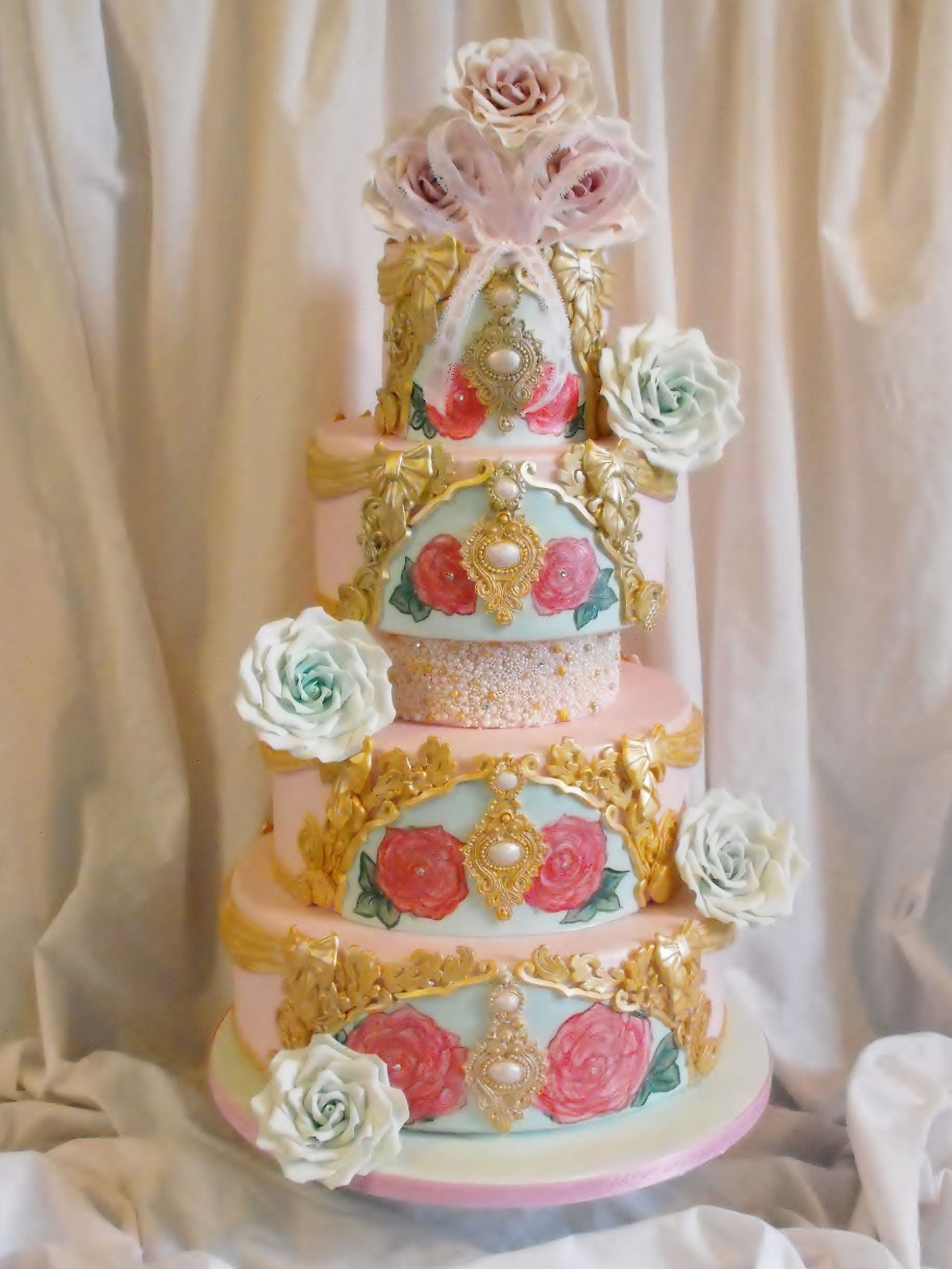 4 tier pink gold and aqua wedding cake