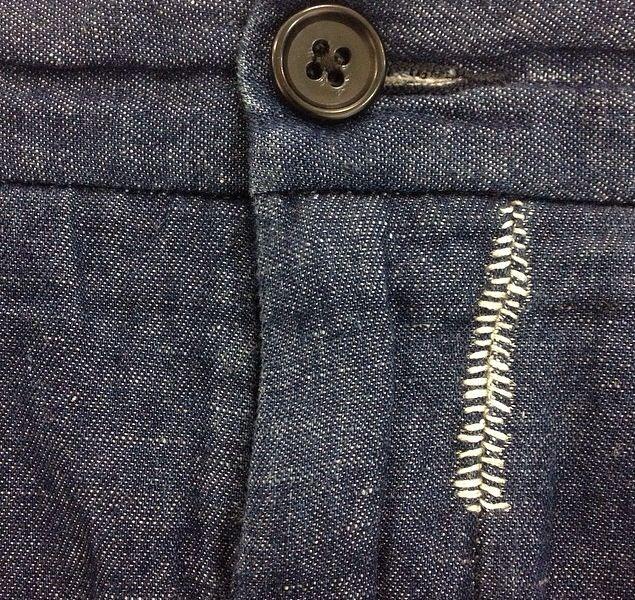 Denim jeans knee repair with sashiko stitching