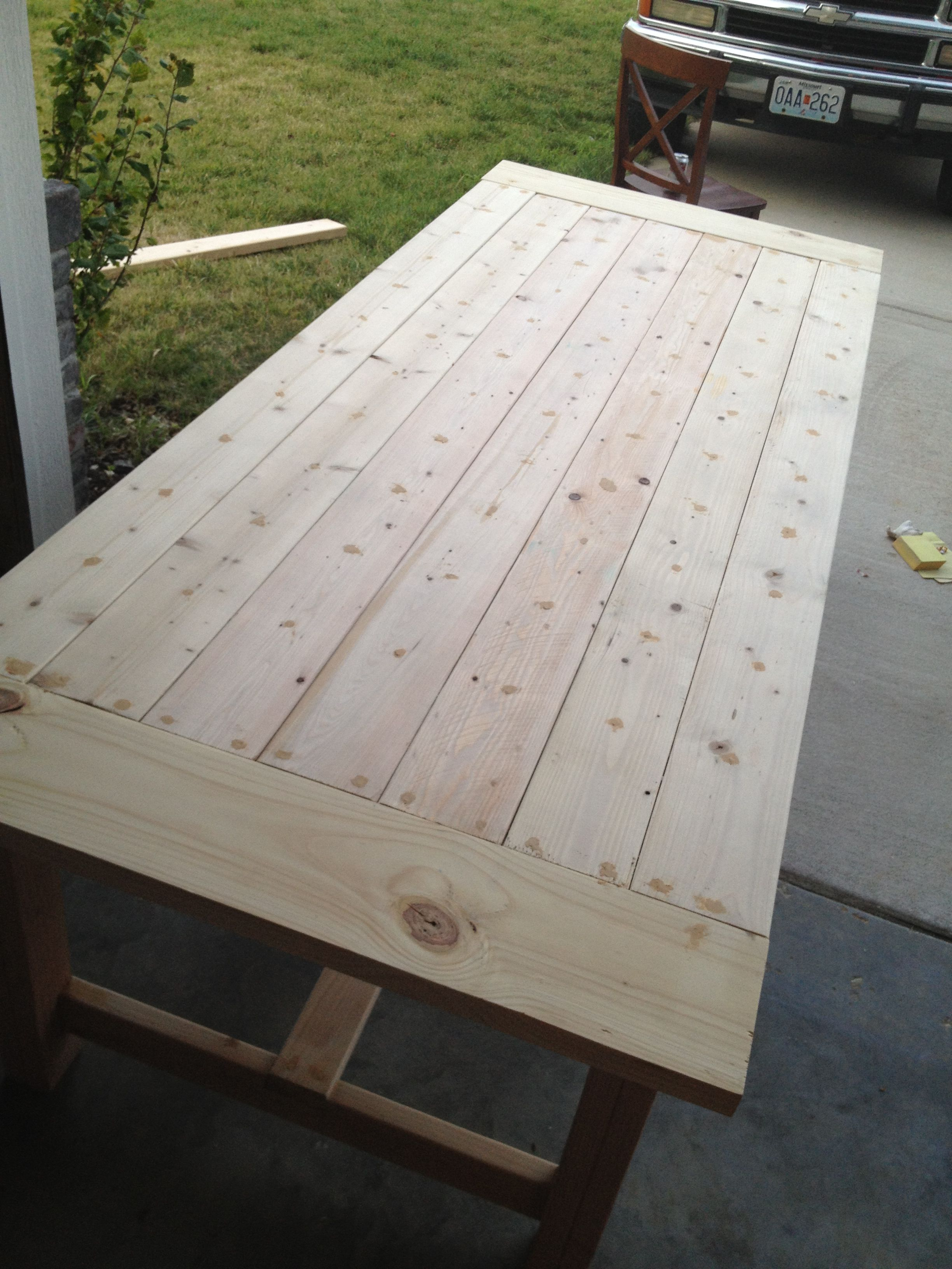 diy barn style dining table sitting around the dining