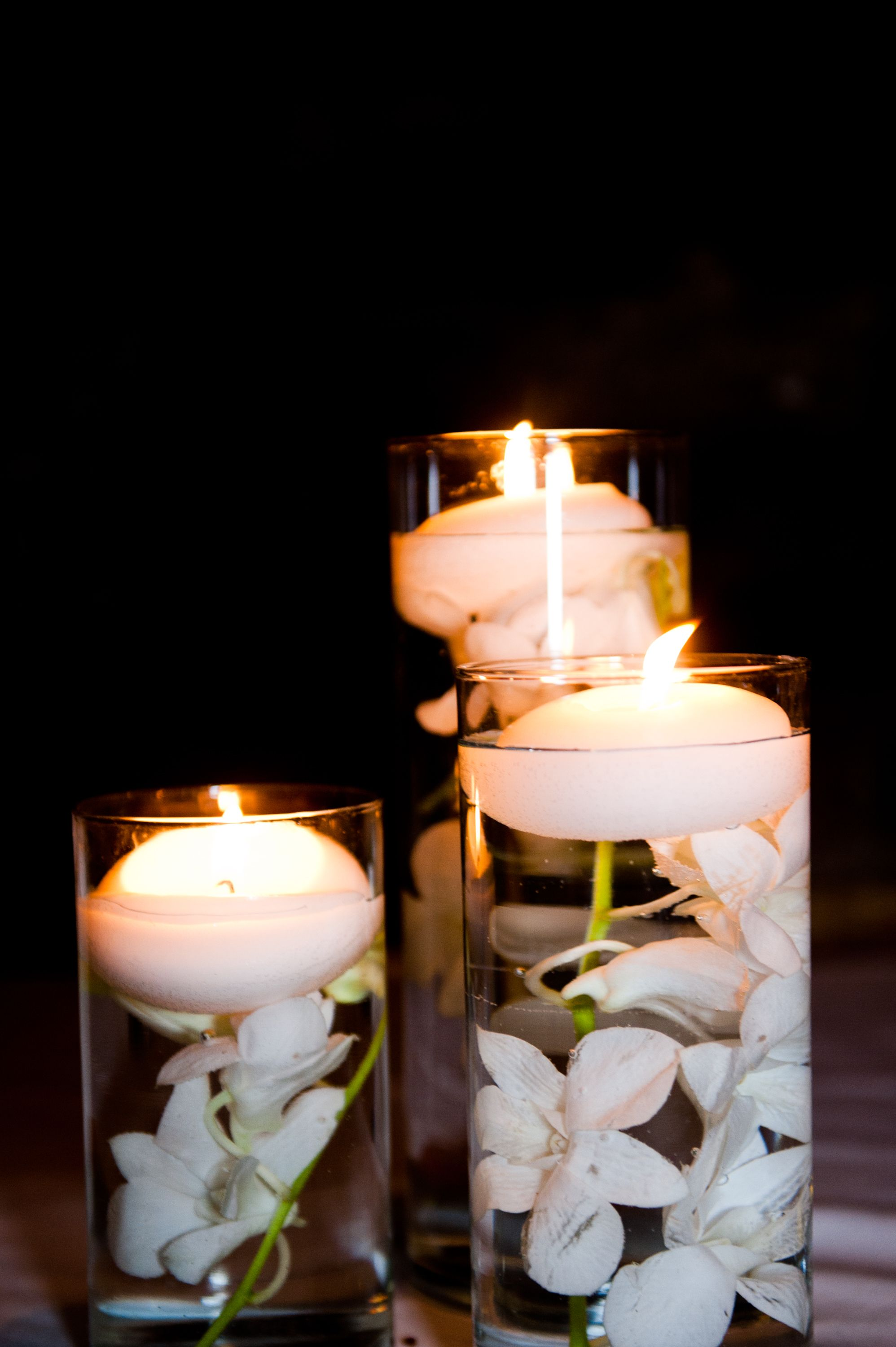 White floating candle table centerpieces here is where
