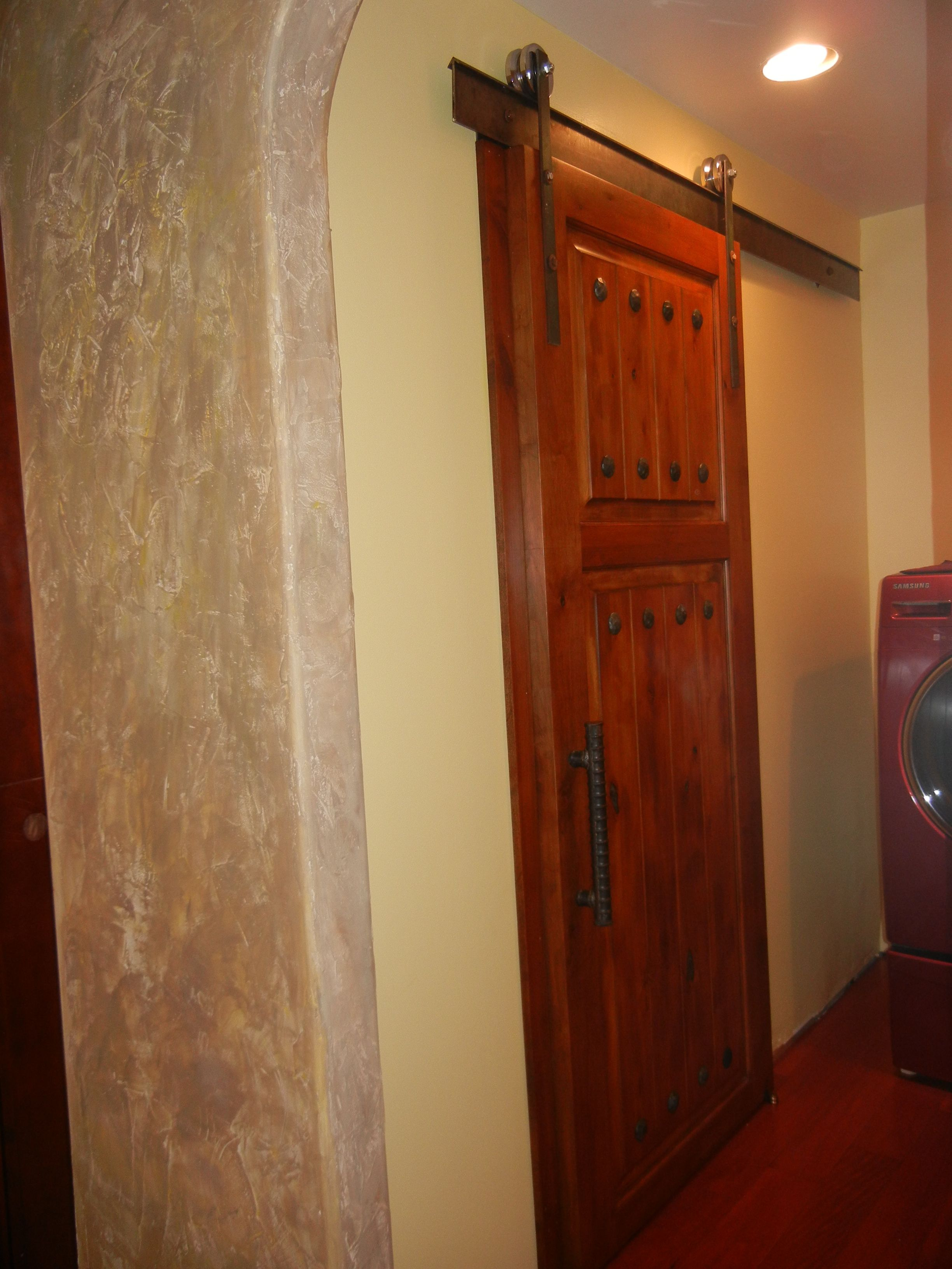 Barn Door Leading To A Rustic Bathroom Home Ideas