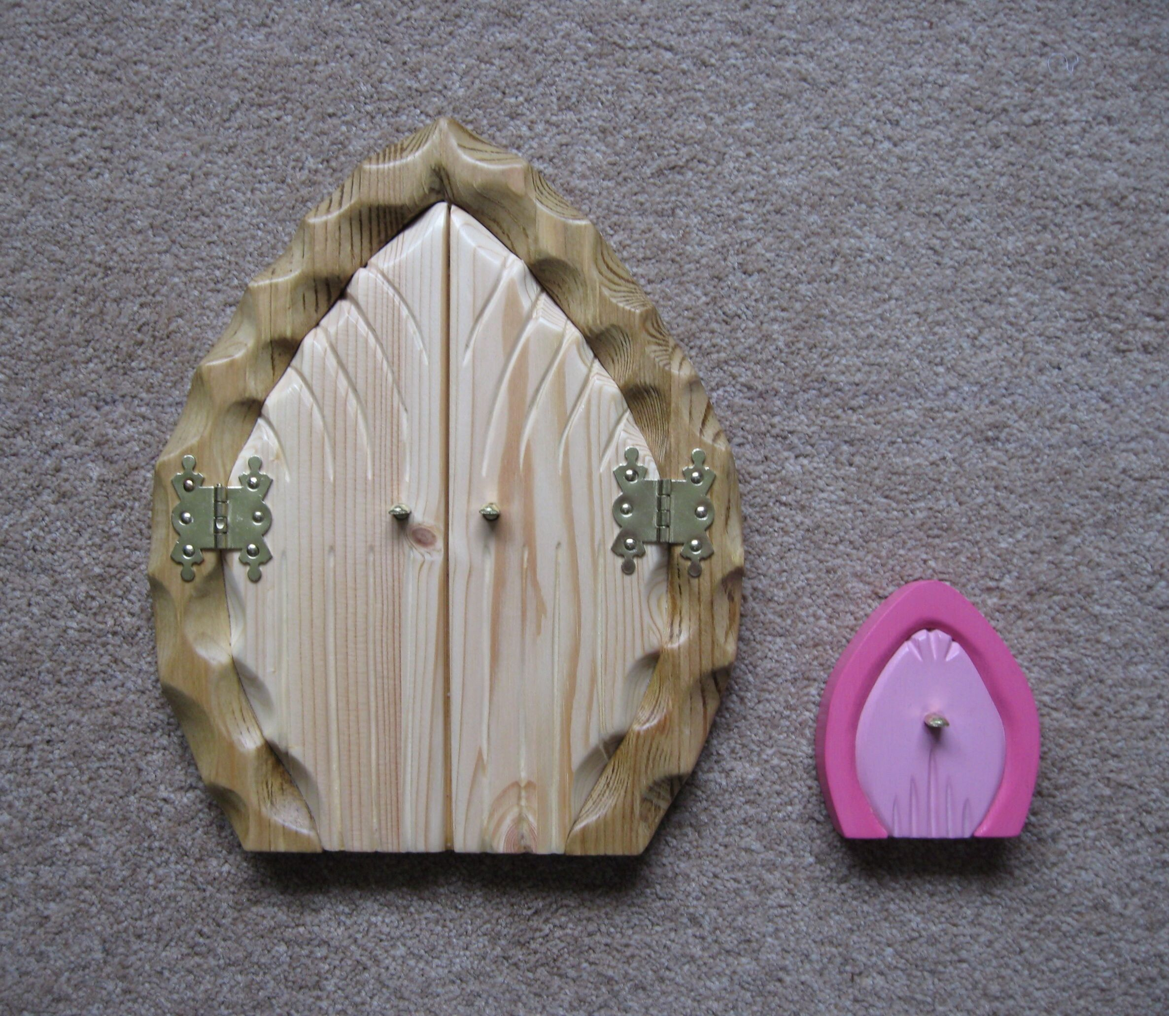 Two carved fairy doors wooden fairy doors pinterest for Wooden fairy doors