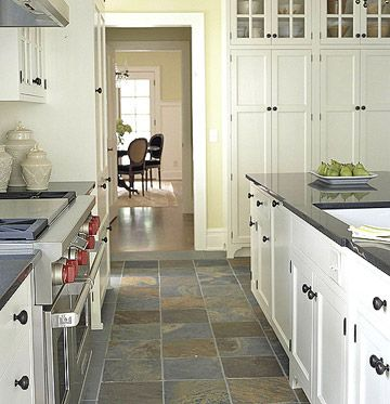 slate floor with white cabinets kitchen