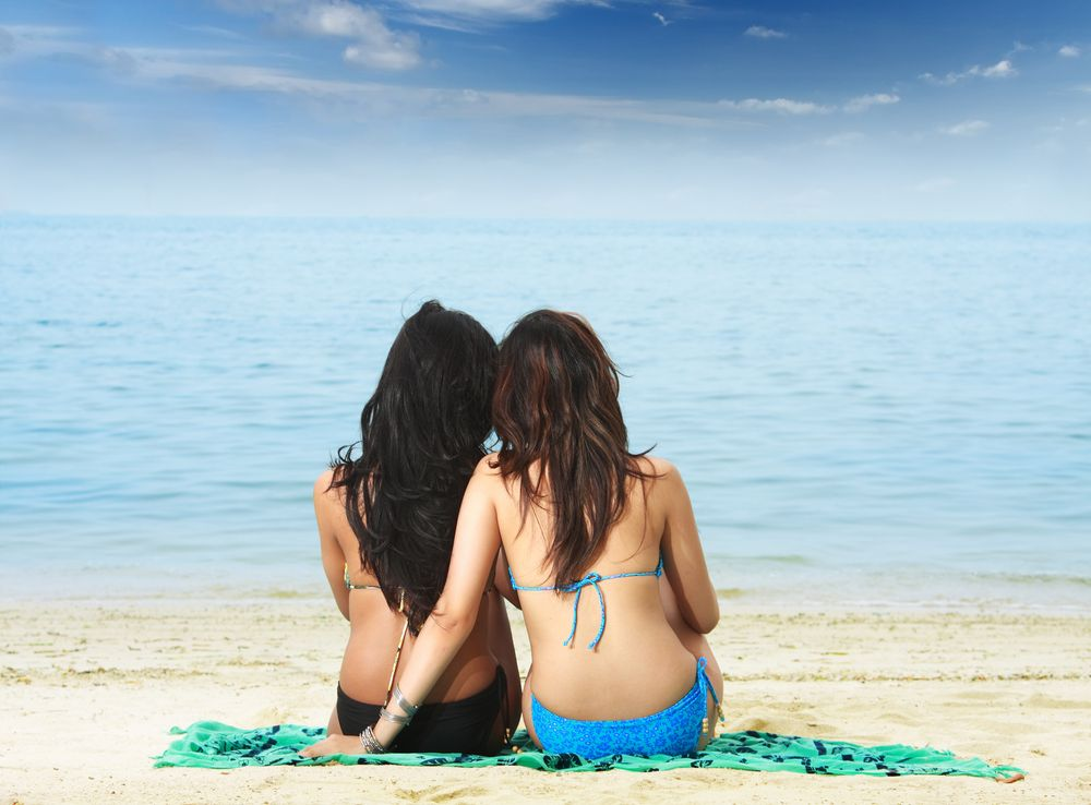 photo of girls sitting in water at beach № 16901
