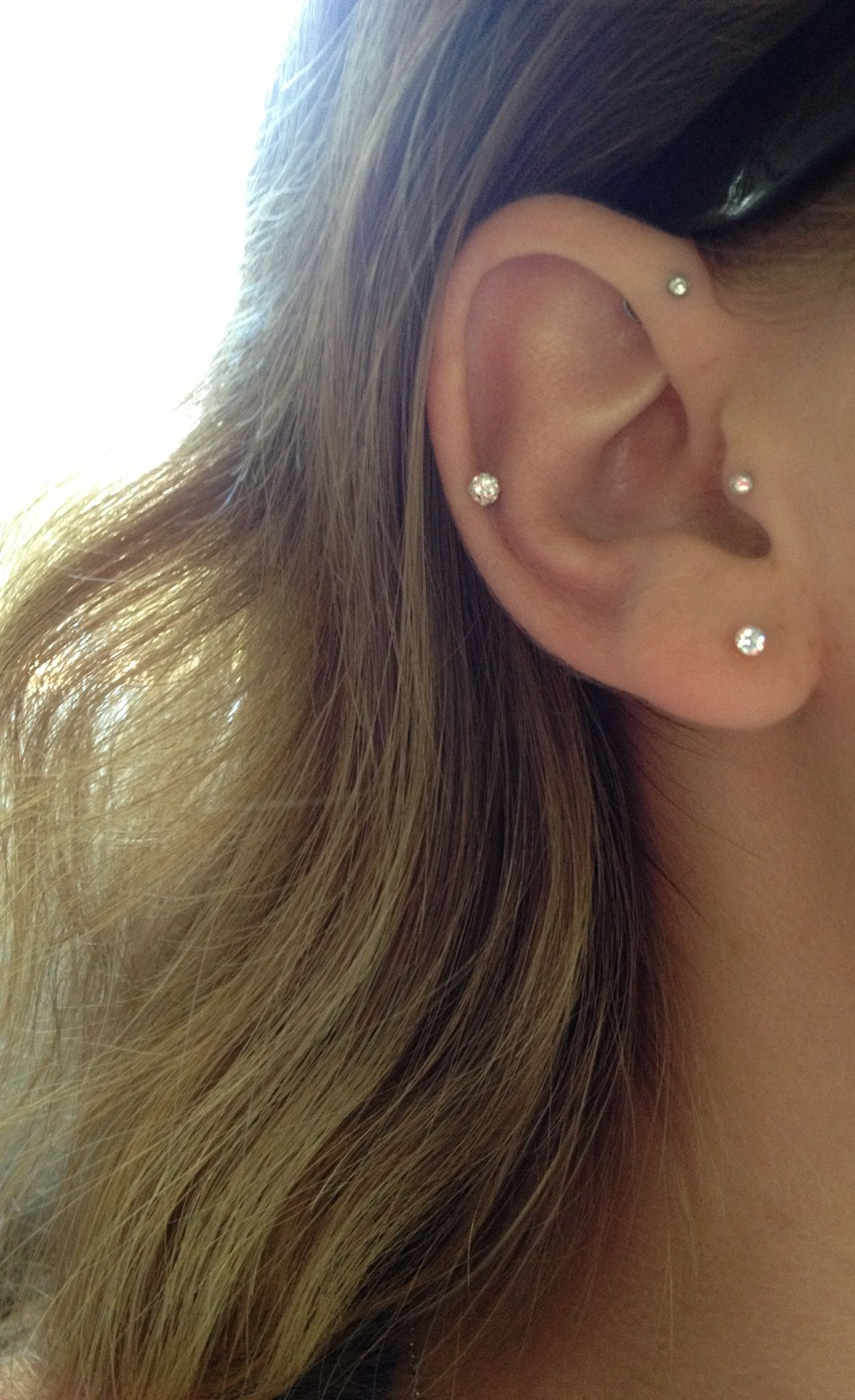 forward helix tragus and helix piercings