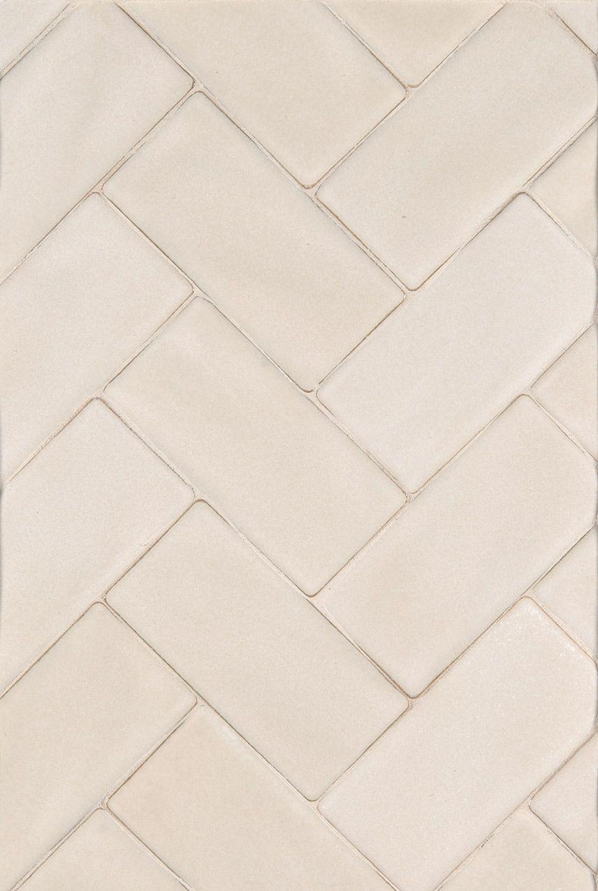 Subway tile in herringbone pattern