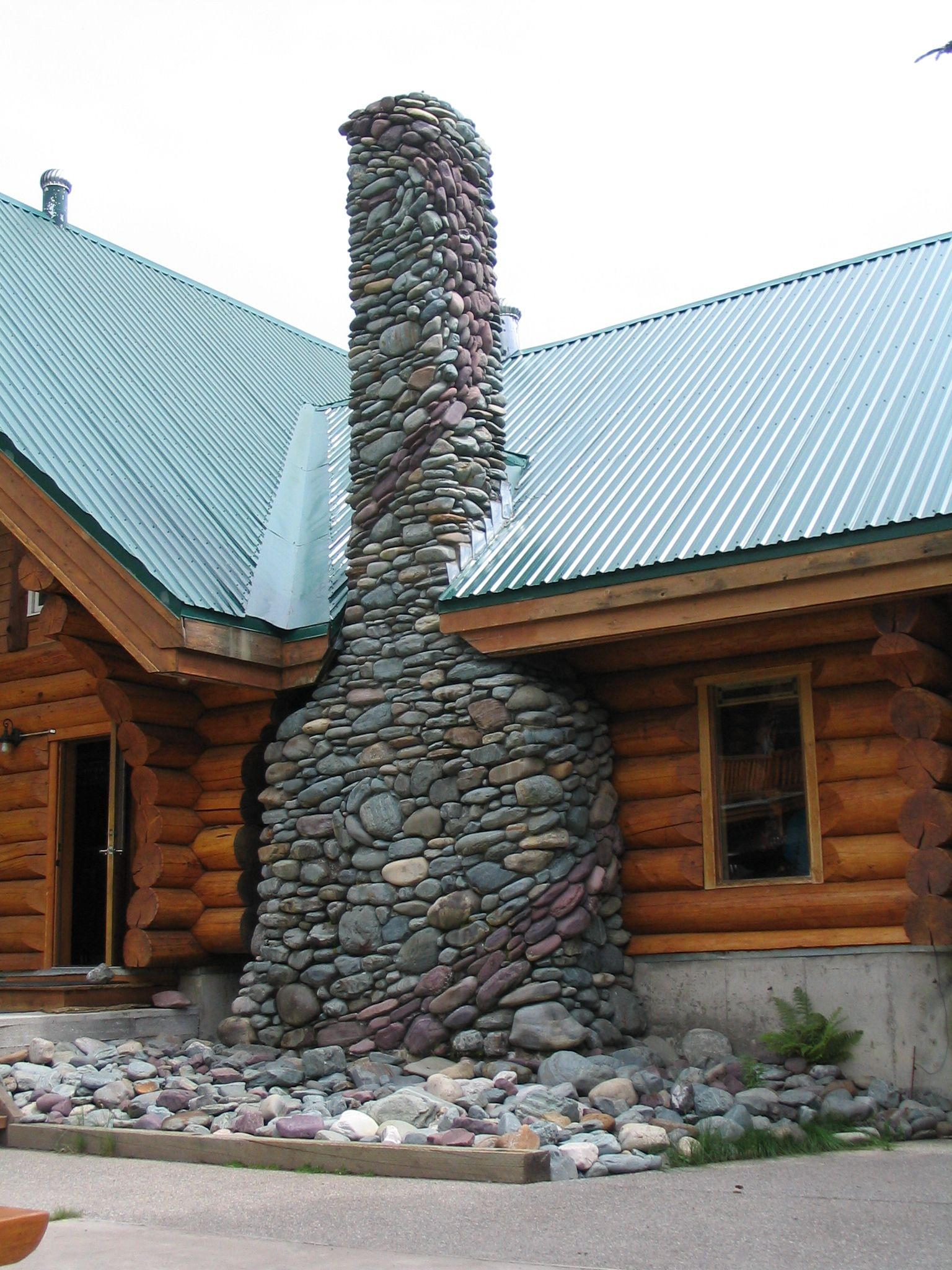 What a stunning stone chimney stack chimneys pinterest for Stone chimneys