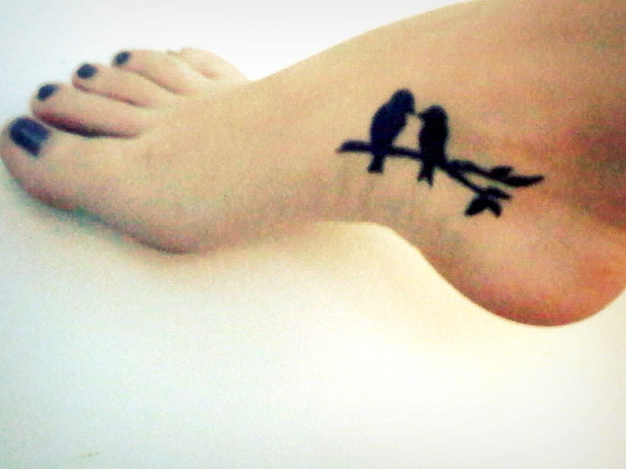 Птицы на двоих тату
