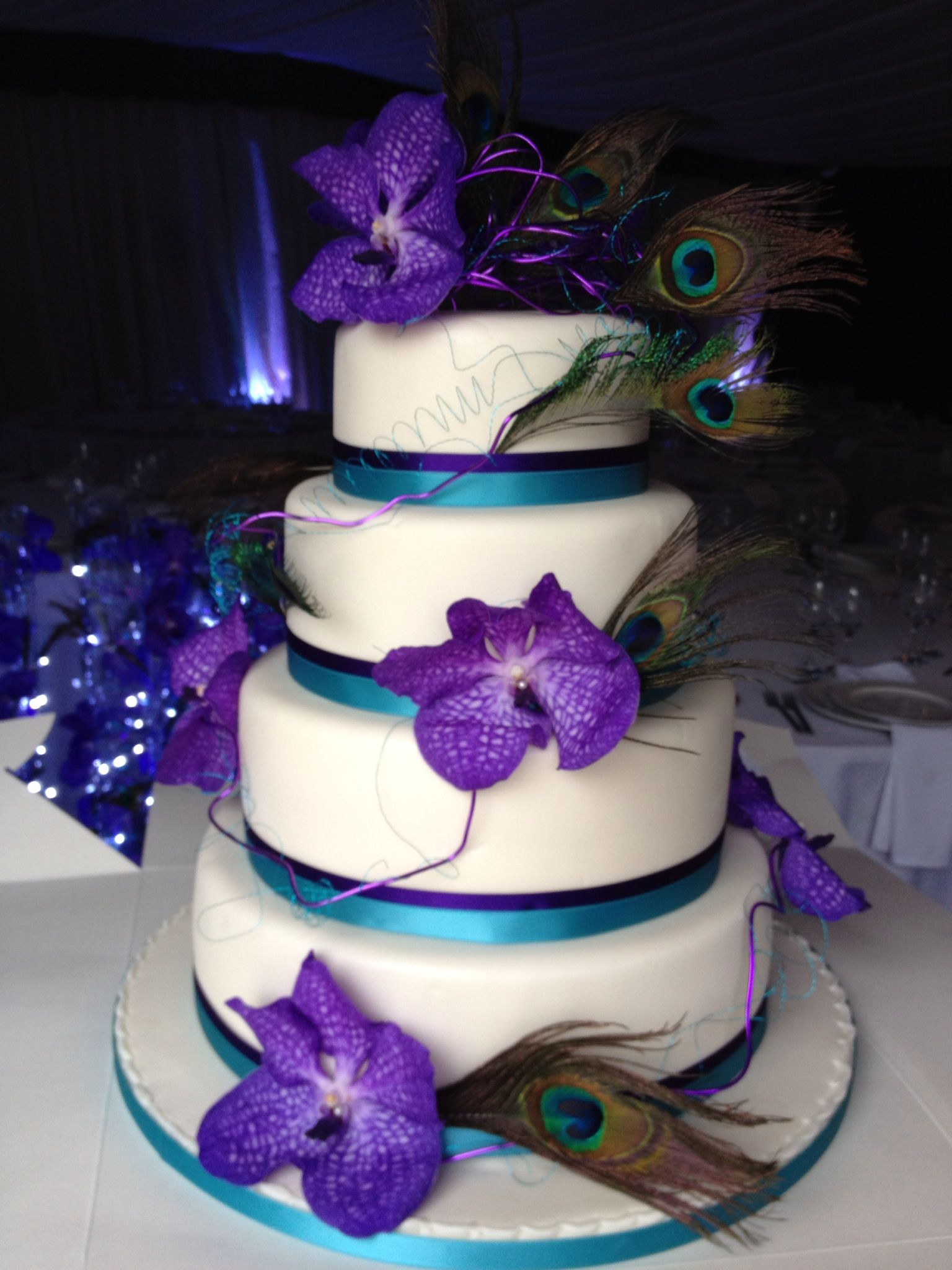 purple and turquoise wedding cake