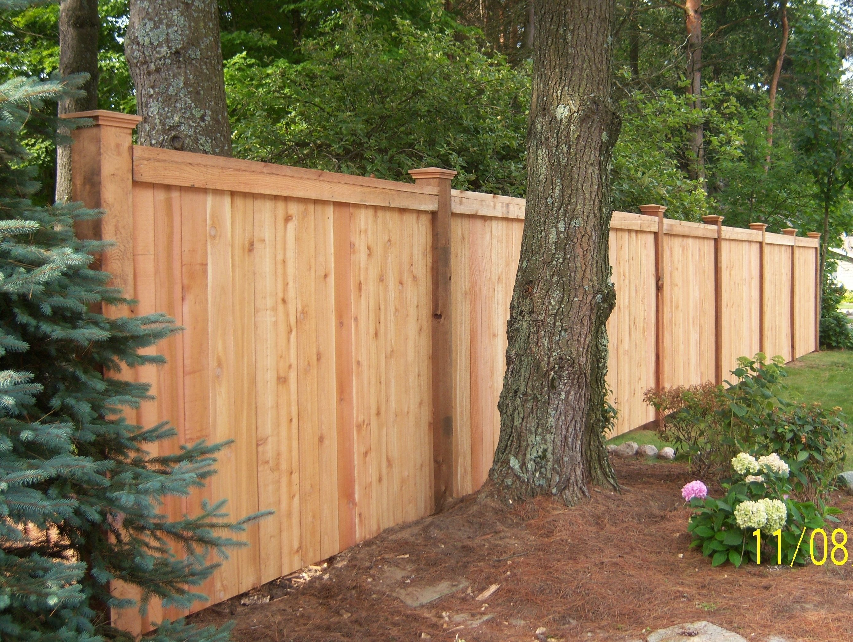 Custom wood privacy fence garden ideas pinterest for Garden fencing ideas privacy