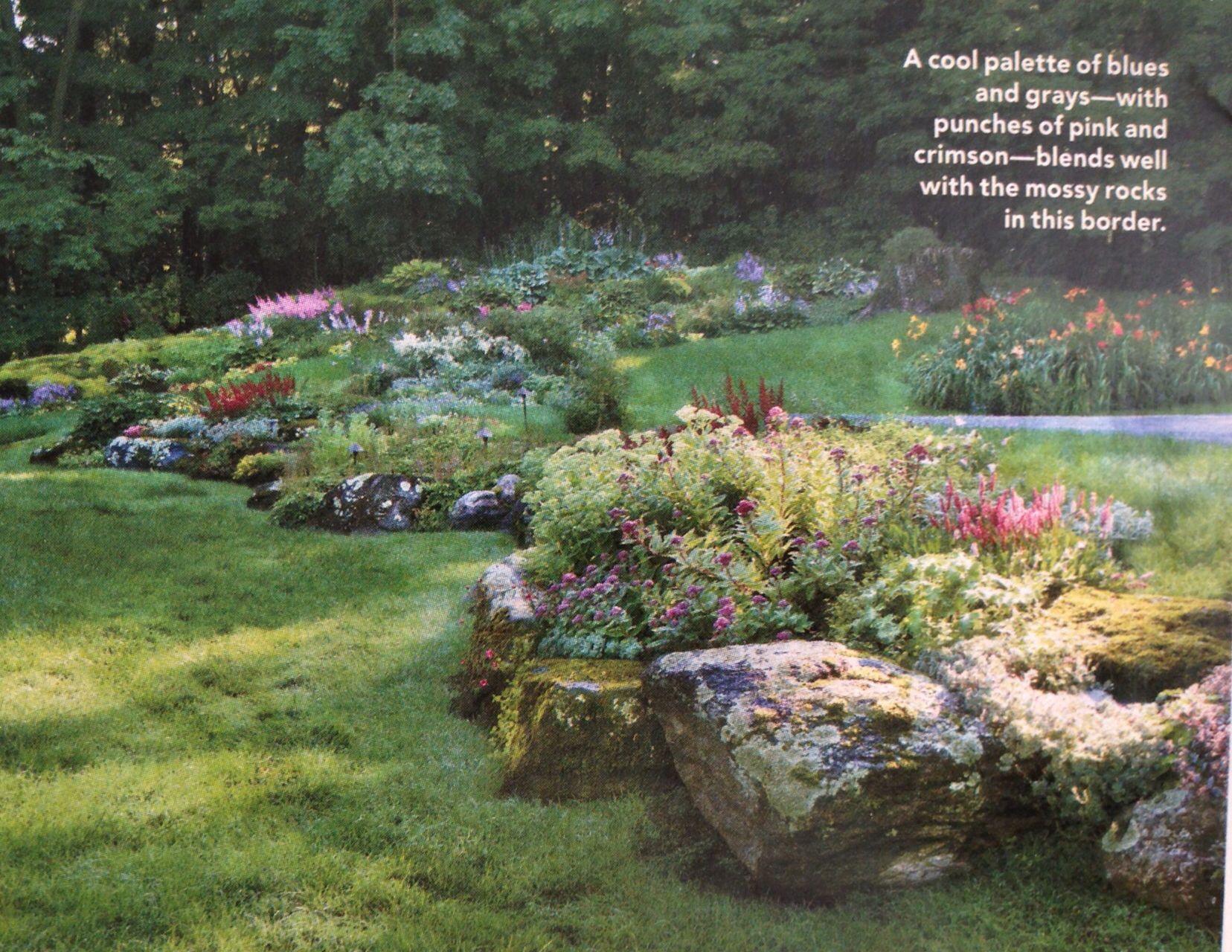 Boulder edged raised flower beds Outside Garden Ideas