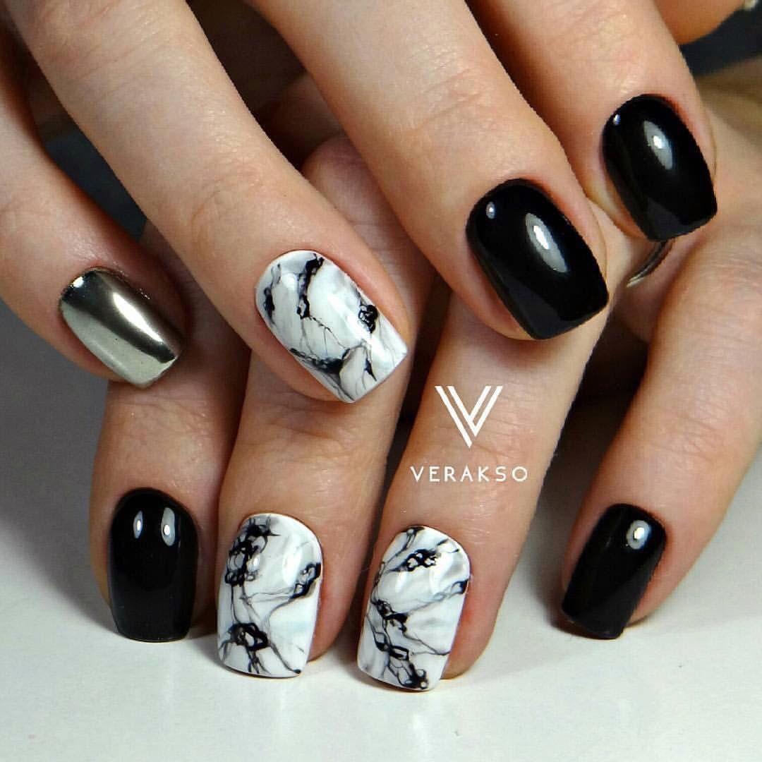 Маникюр черные ногти и один белый
