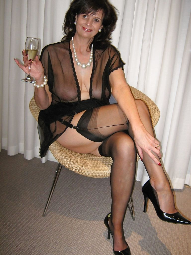 Dirty GILF wearing seductive see through dress and ...