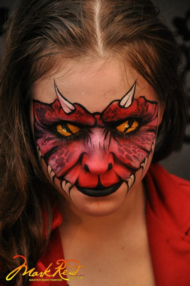 Face painting dragon on arm