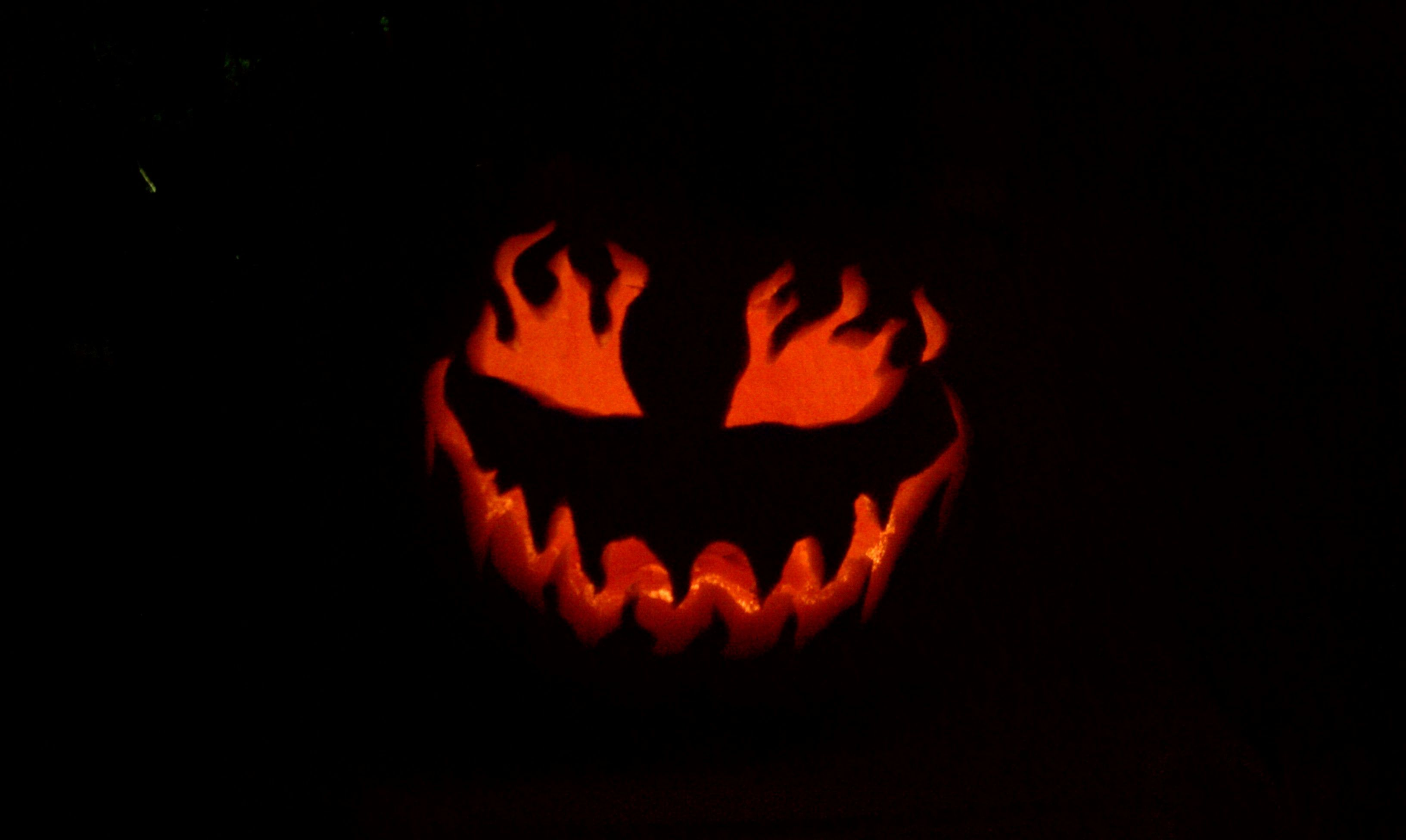Scary face lit up pumpkin carving halloween pinterest