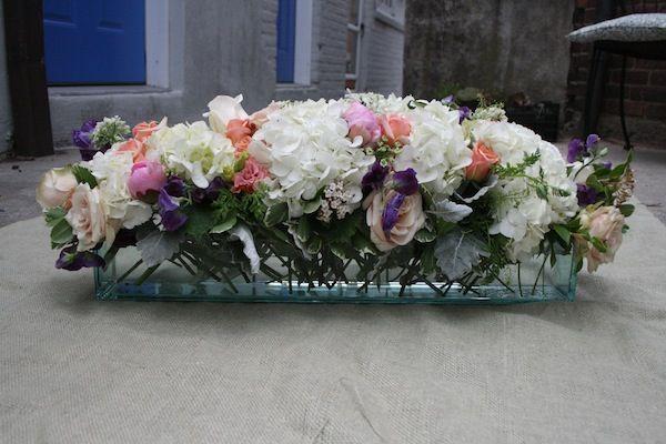 Long low wedding centerpiece flowers center