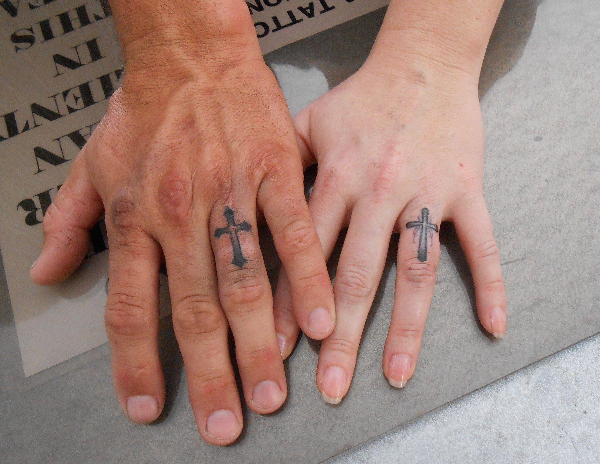 Ring finger cross tattoos tattoos expression of art for Cross tattoos on finger