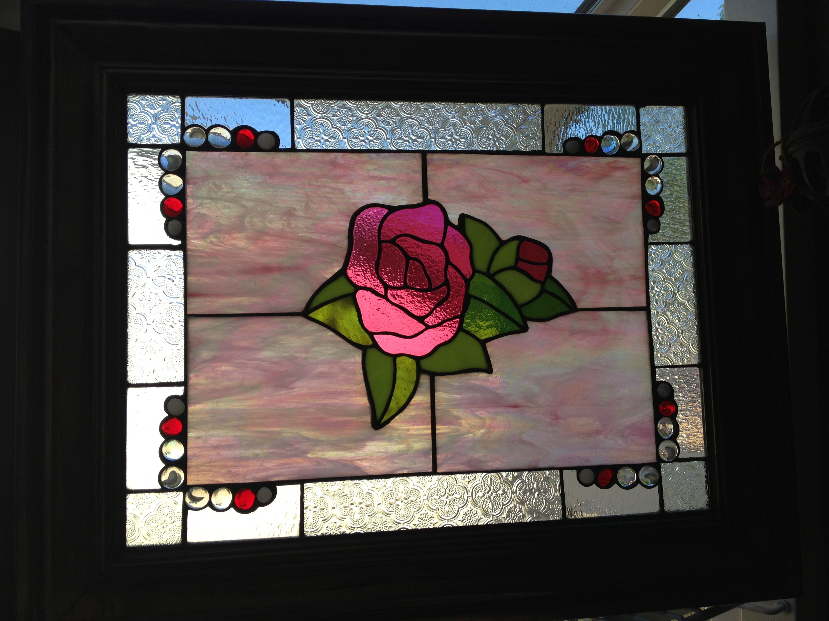stained glass in alder wood frame stained glass