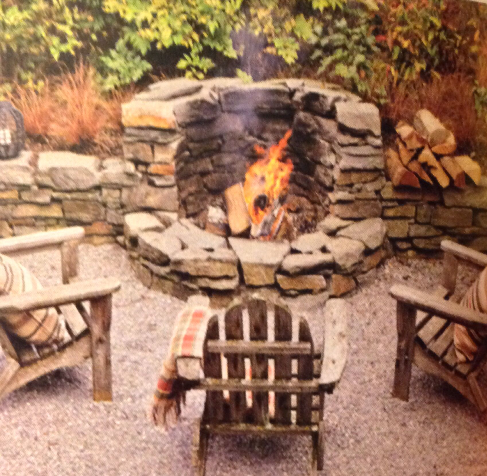 fire pit with stacked stone seating wall garden design