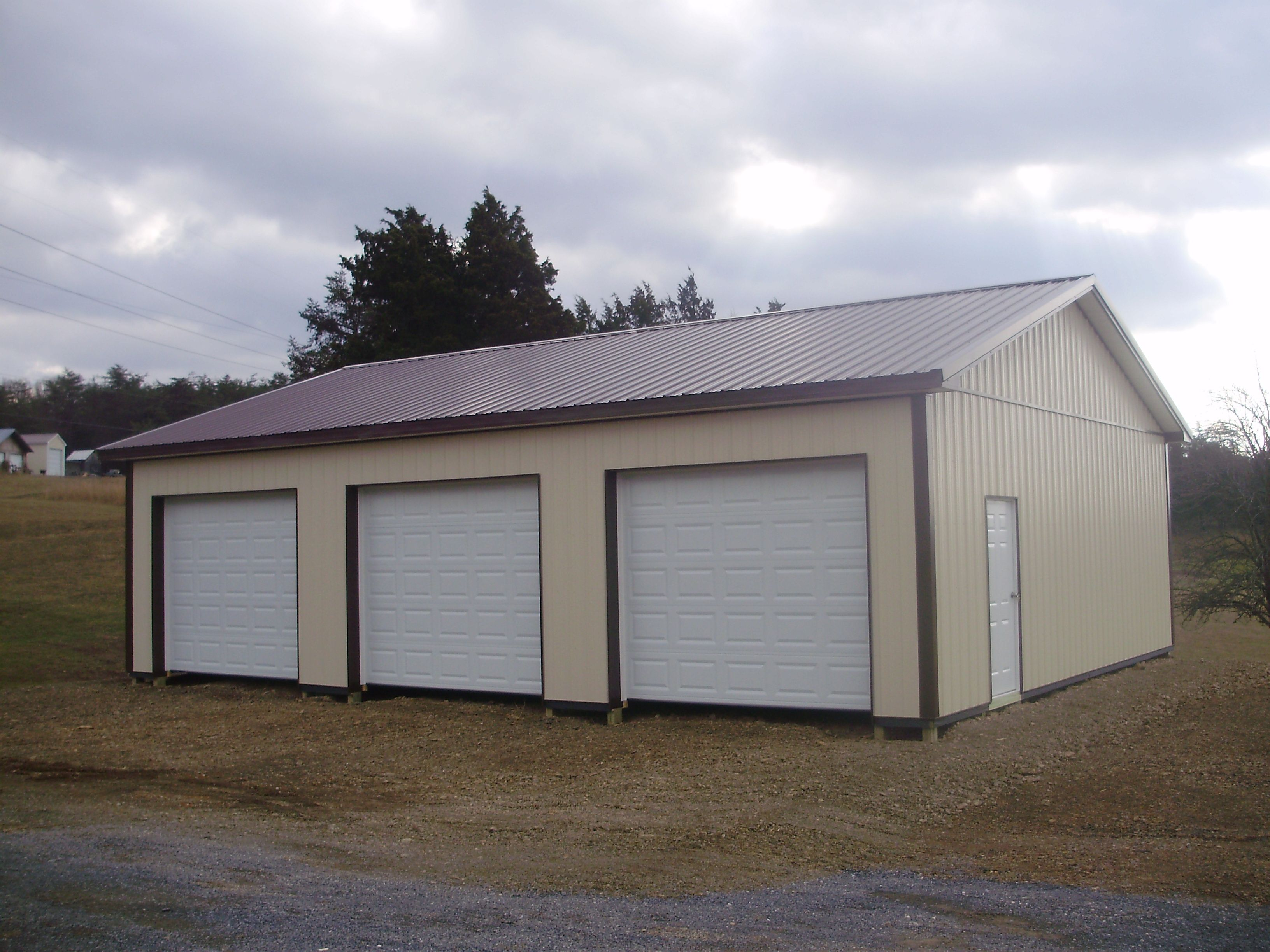 Pin by pioneer pole buildings inc on three car garages for 4 car pole barn