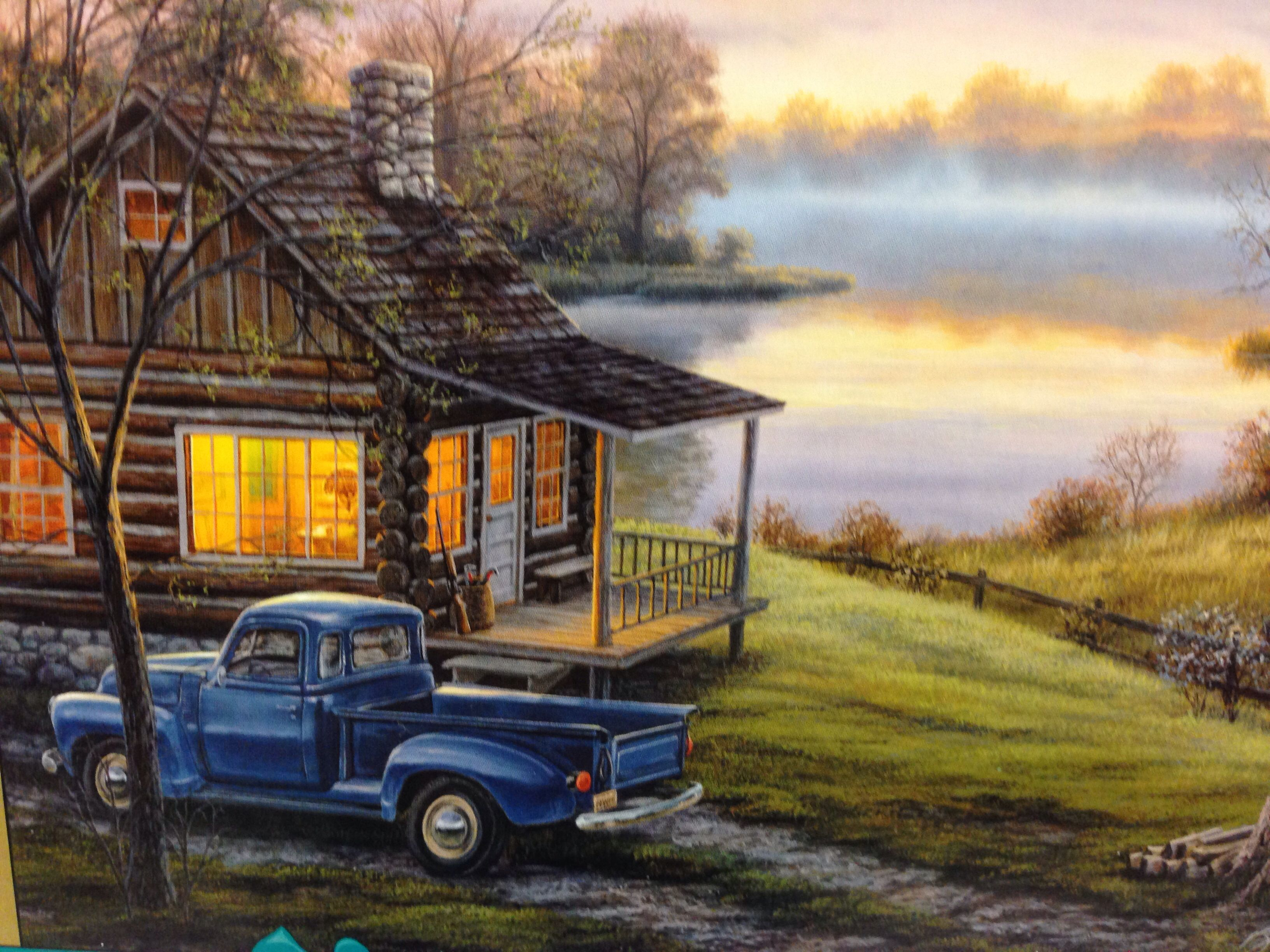 log cabin scene on a puzzle log cabins and mountains