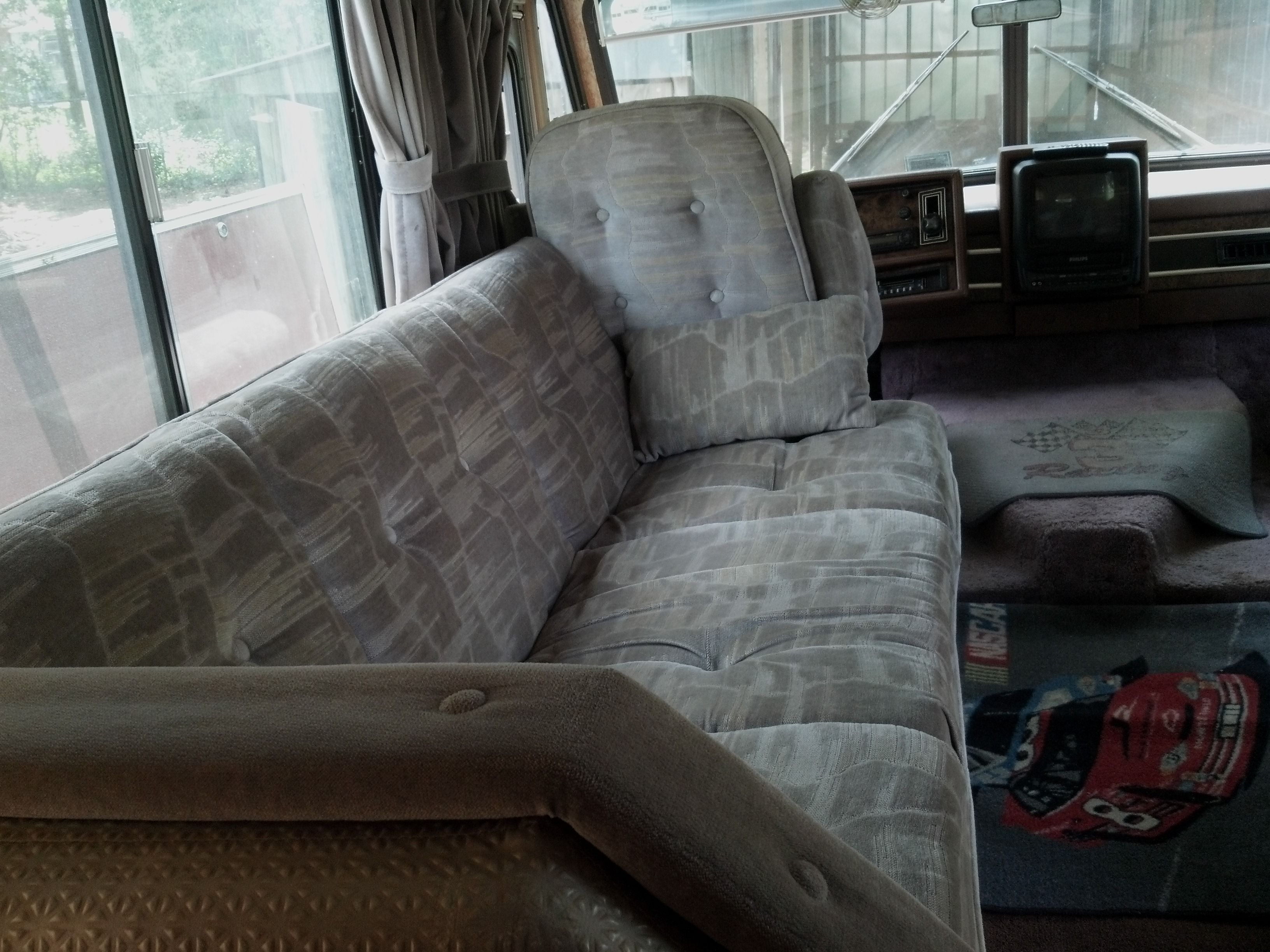 This couch turns into a bed.  Interior of camper, motor homes, pull ...