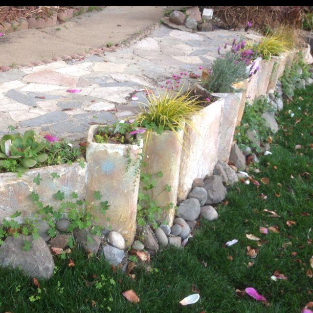 Love these funky planters garden ideas pinterest for Garden designs pinterest