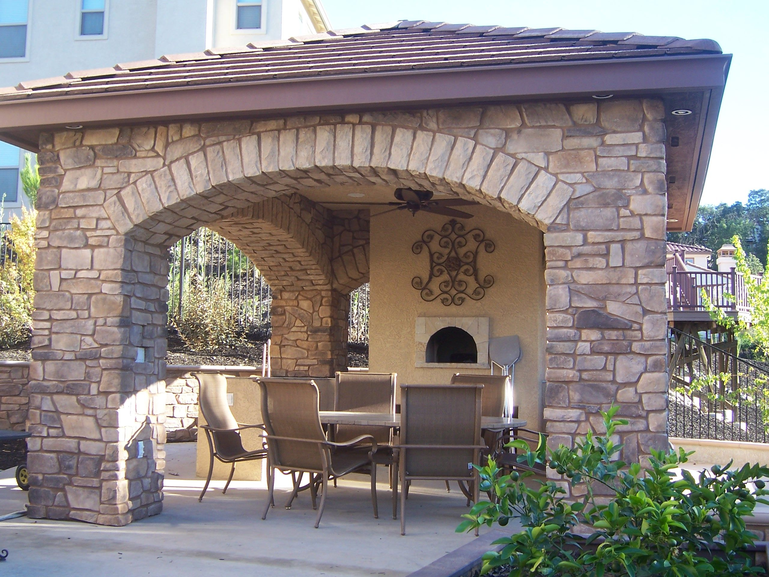 Outdoor fireplace for the back yard pinterest for Covered outdoor kitchen ideas