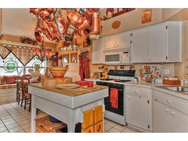 white kitchen w copper pots  Kitchen ideas  Pinterest