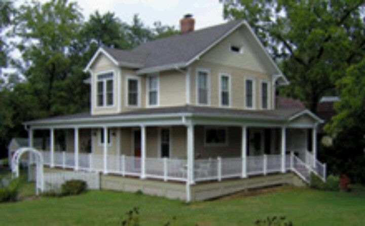 wrap around porch this country home