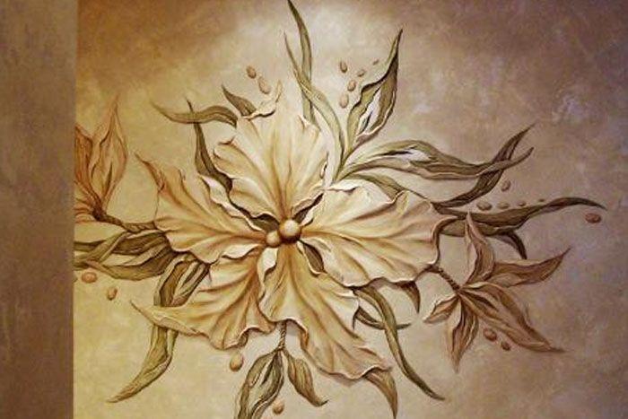 Барельефы цветы на стене