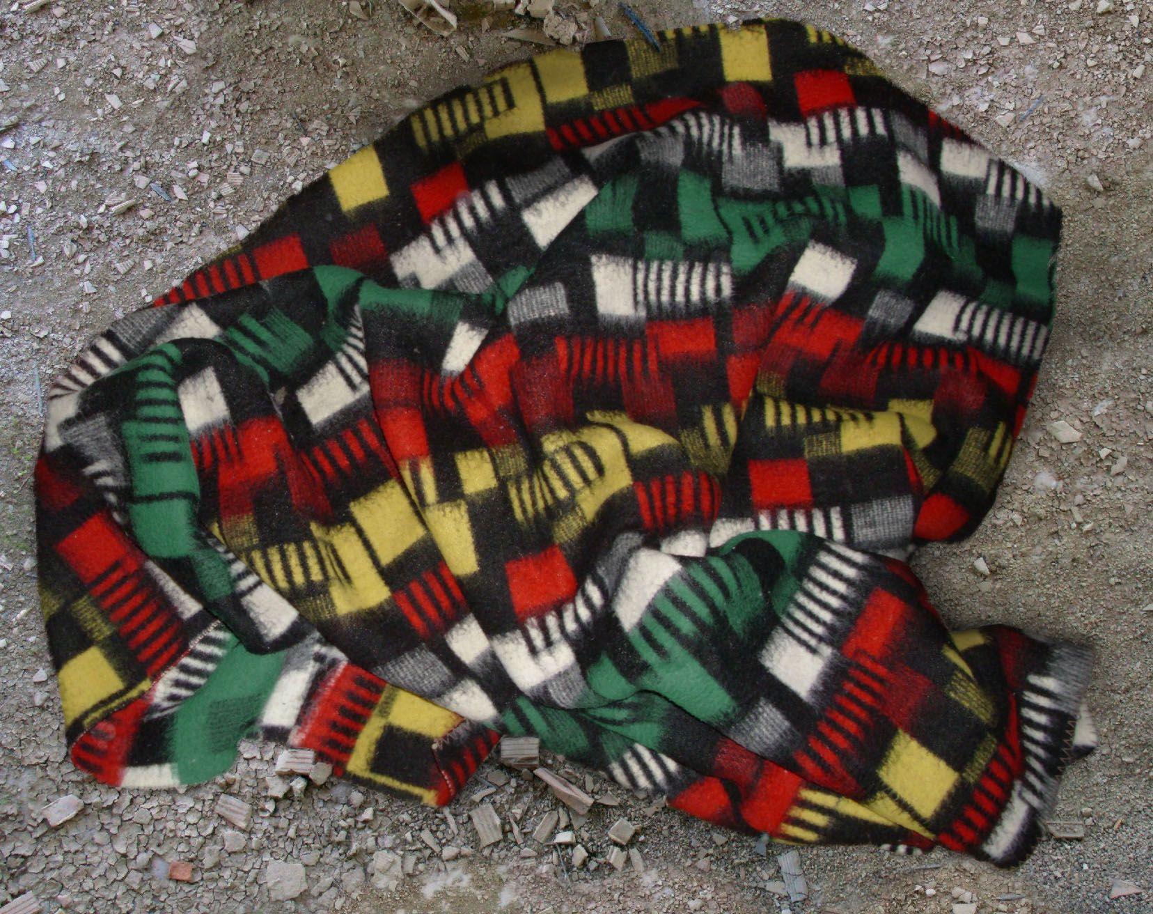 old blanket on dirty floor vintage retro 50s 60s woolen