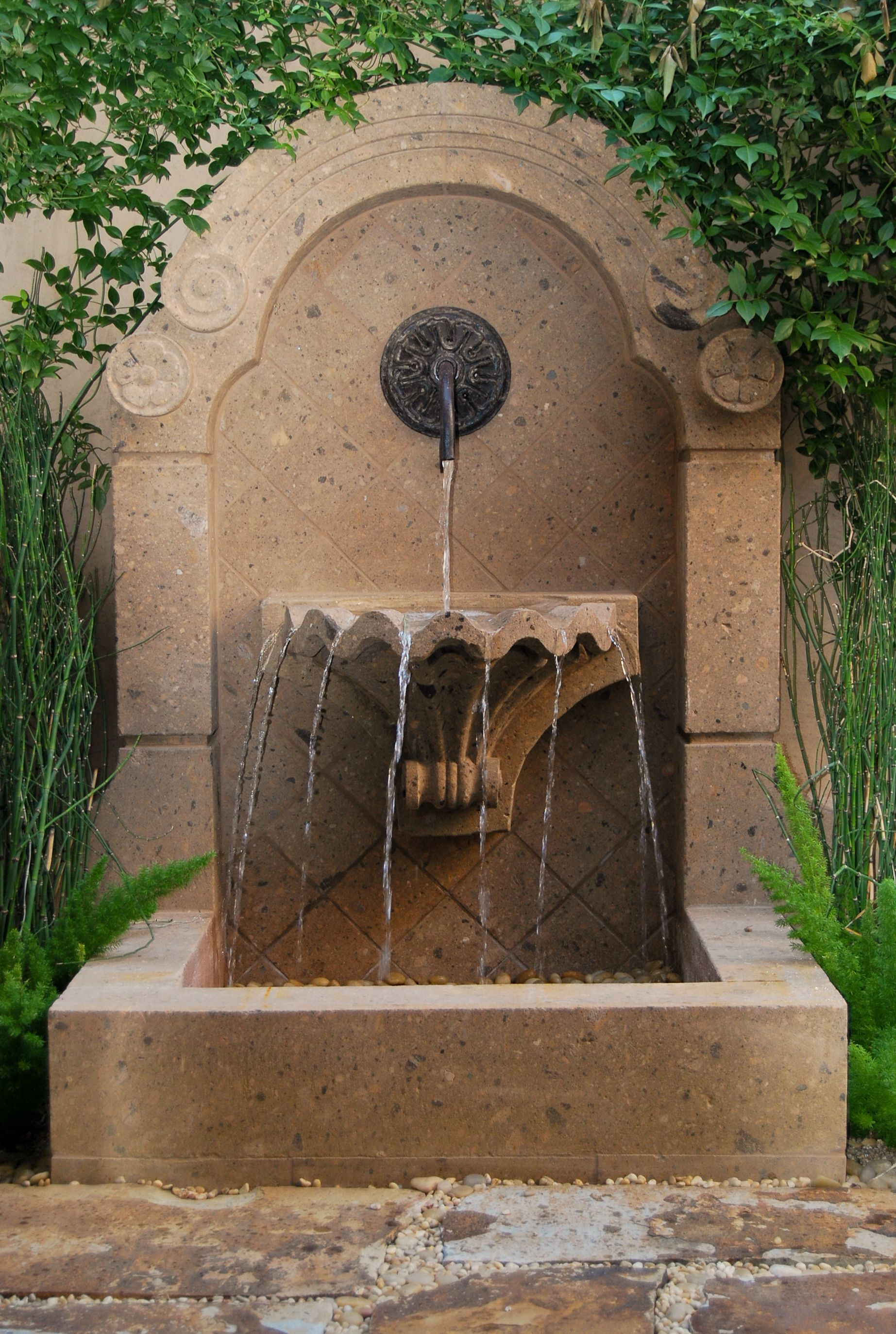 wall fountain courtyard pinterest