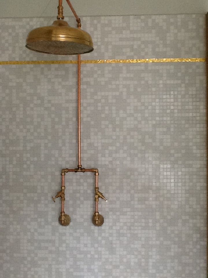 Exposed copper piping shower bathroom pinterest for What are old plumbing pipes made of
