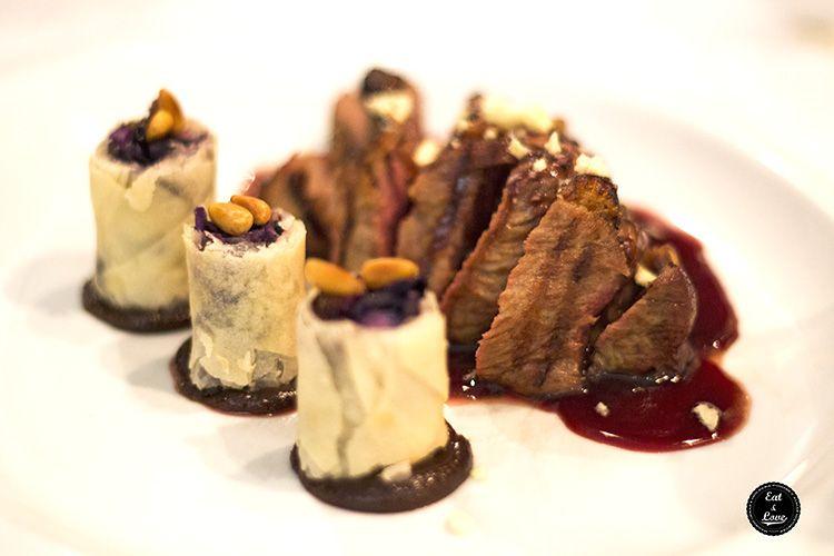 Presa ibérica de pura raza con rollito de lombarda y piñones - Restaurante Metro Bistro Madrid