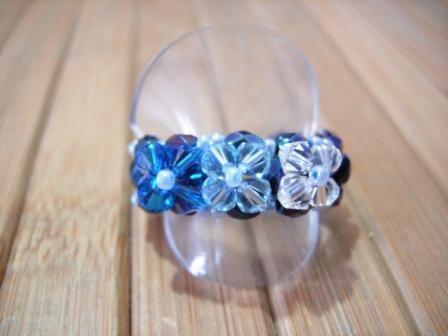 Anillo tres flores azul