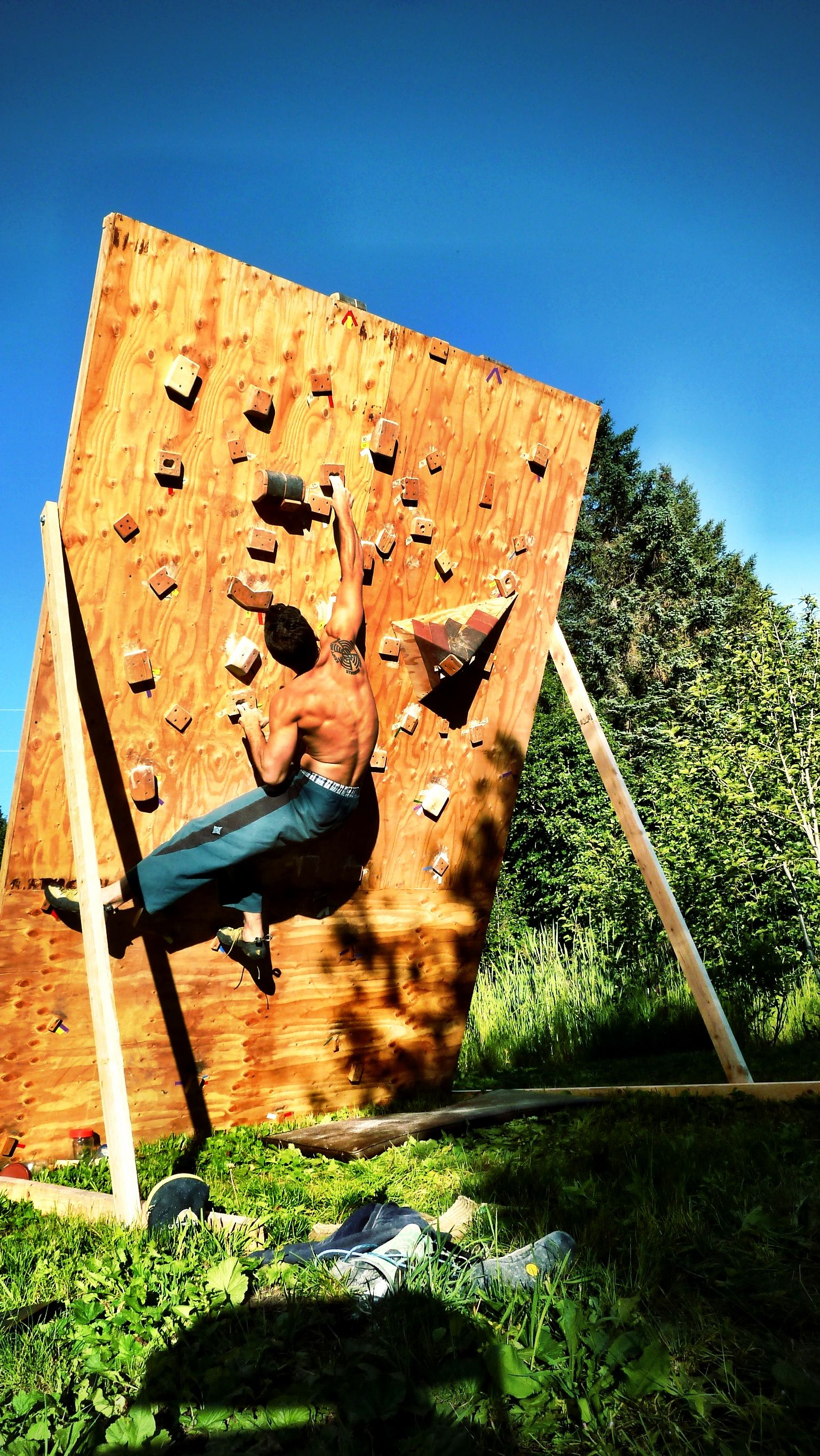 My man on his homemade bouldering wall Climbing bouldering