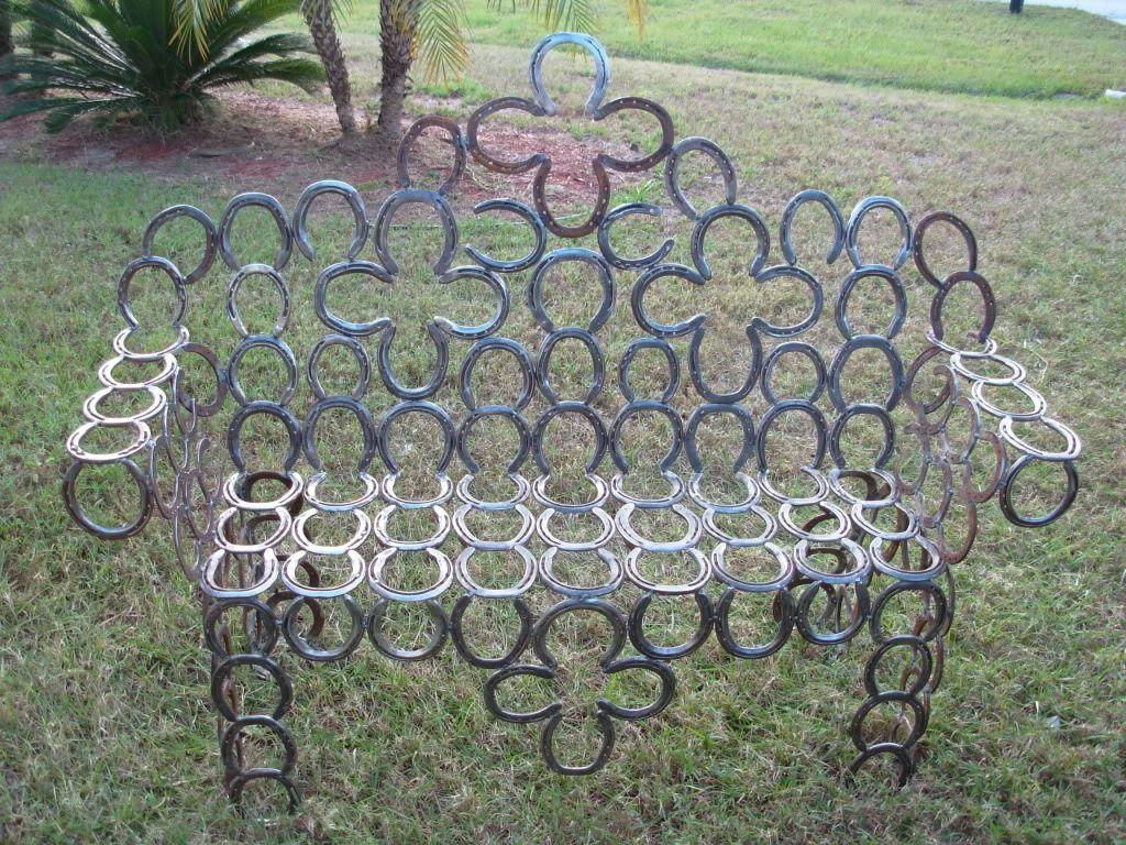 Horseshoe bench welding pinterest for Welded garden art designs