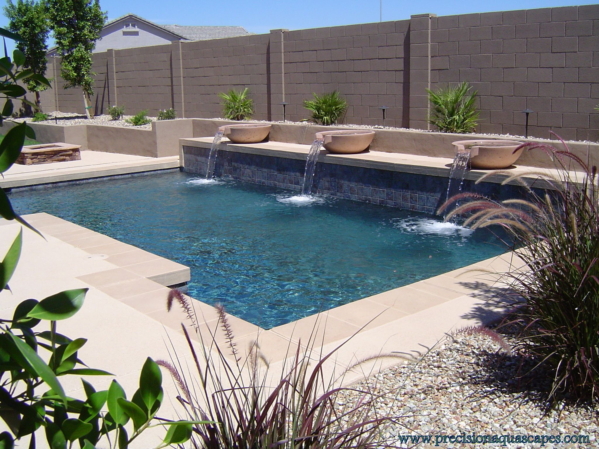 Geometric with raised wall and woks swimming pools for Raised pool designs