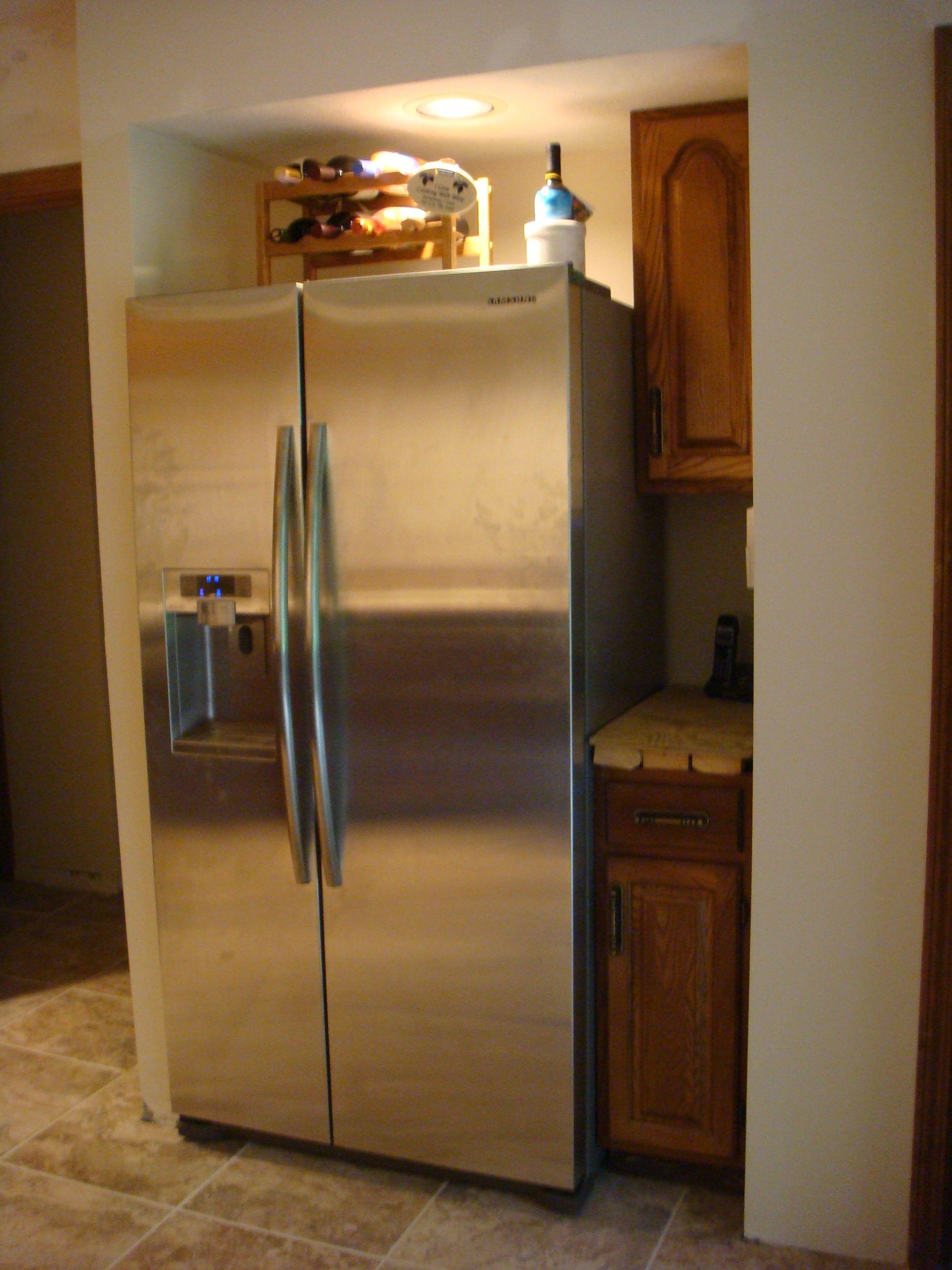 cabinets relocated around refrigerator kitchen remodel