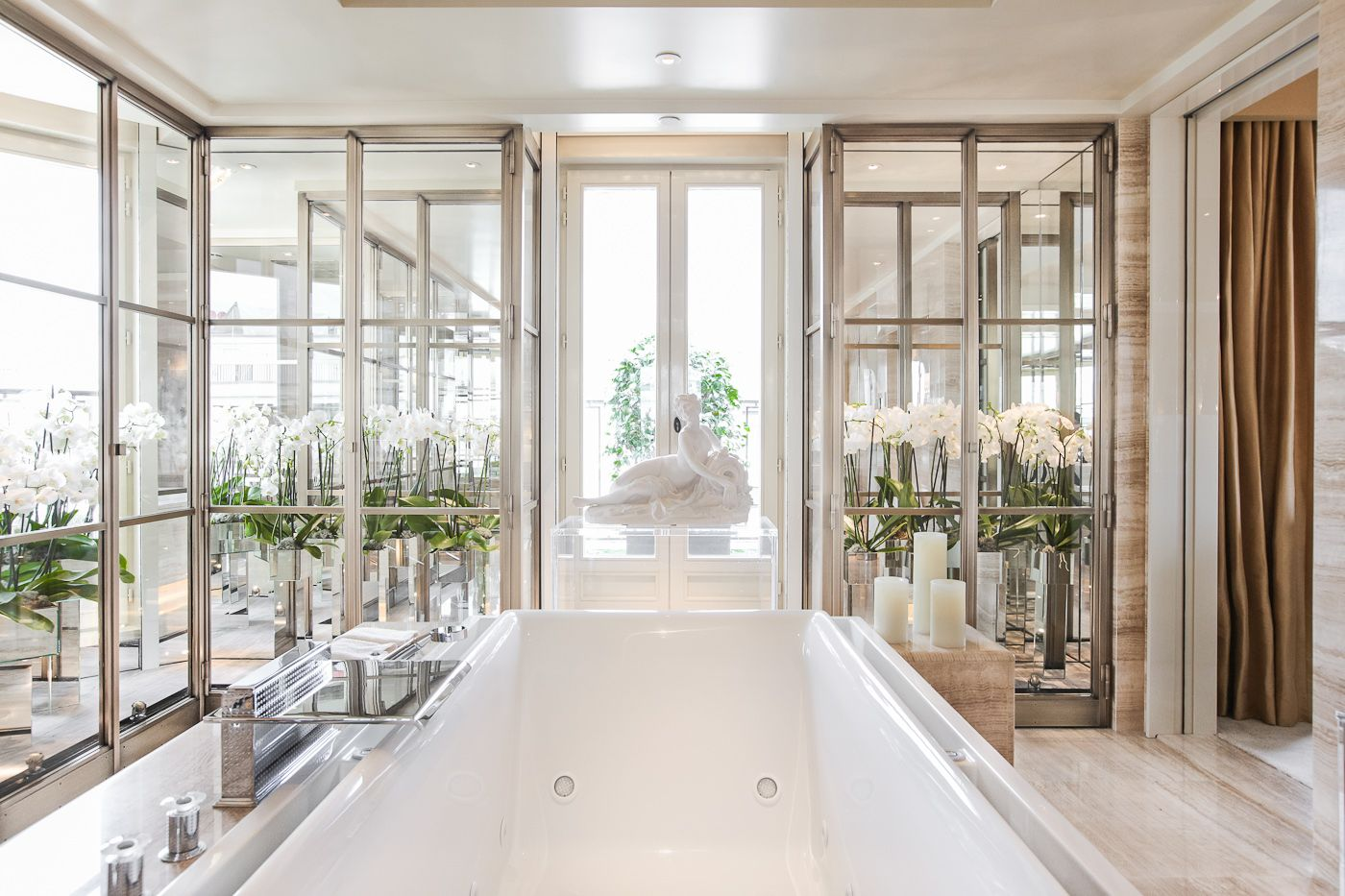 Bathroom with glass, flowers, and lots of light at Four Seasons ...
