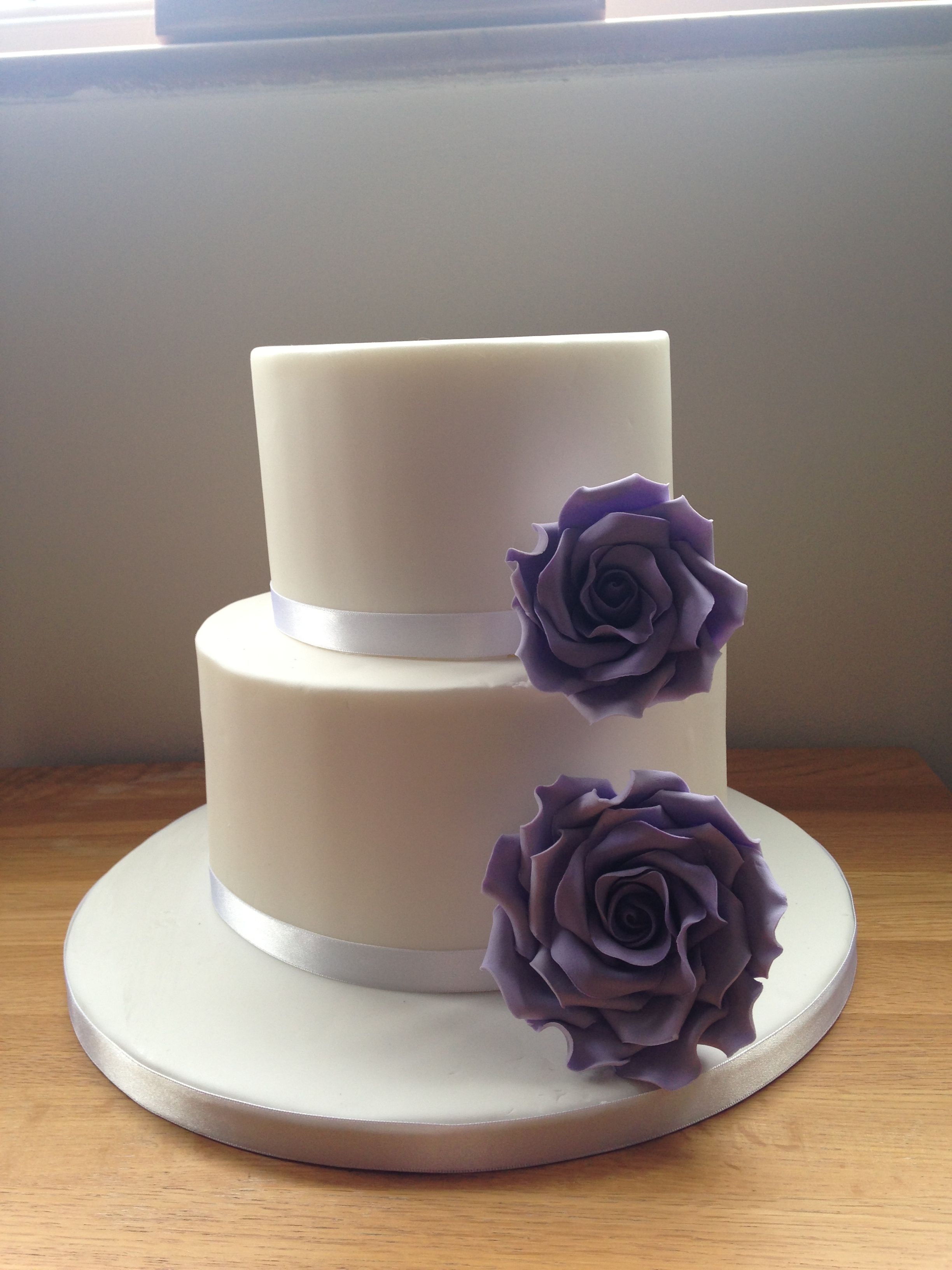2 tier wedding cake purple roses flowers