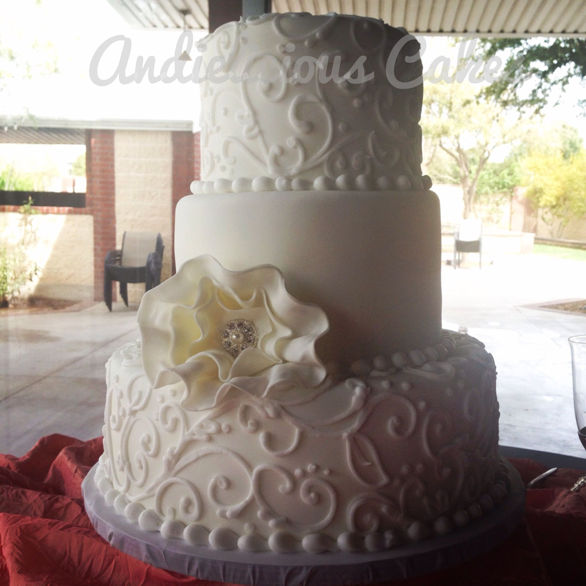 Simple white ruffle flower wedding cake