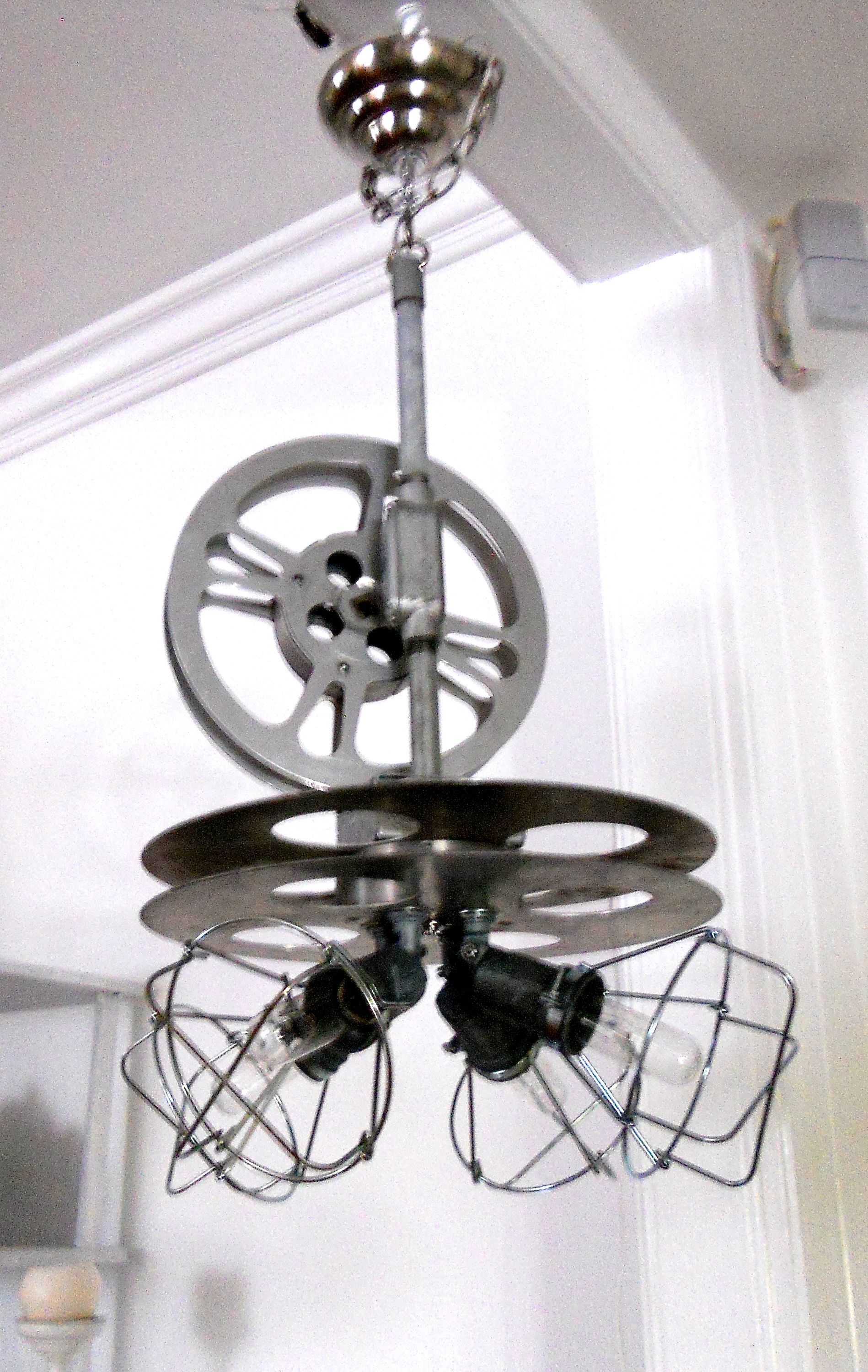 Reel and Pipes Chandelier Chandeliers