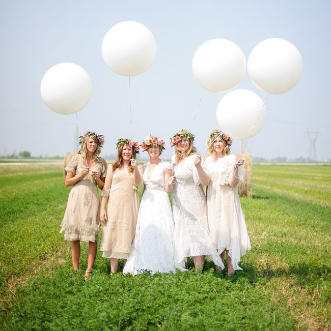 bridesmaids holding white balloons