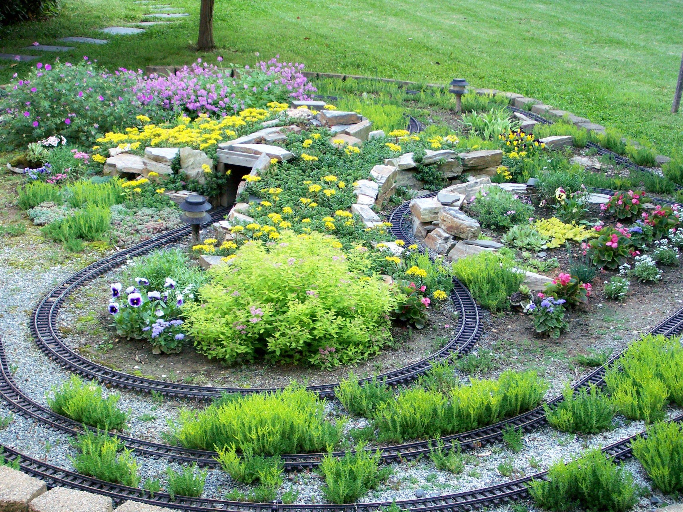 Outdoor train garden 2009 garden railroad pinterest for Garden railway designs