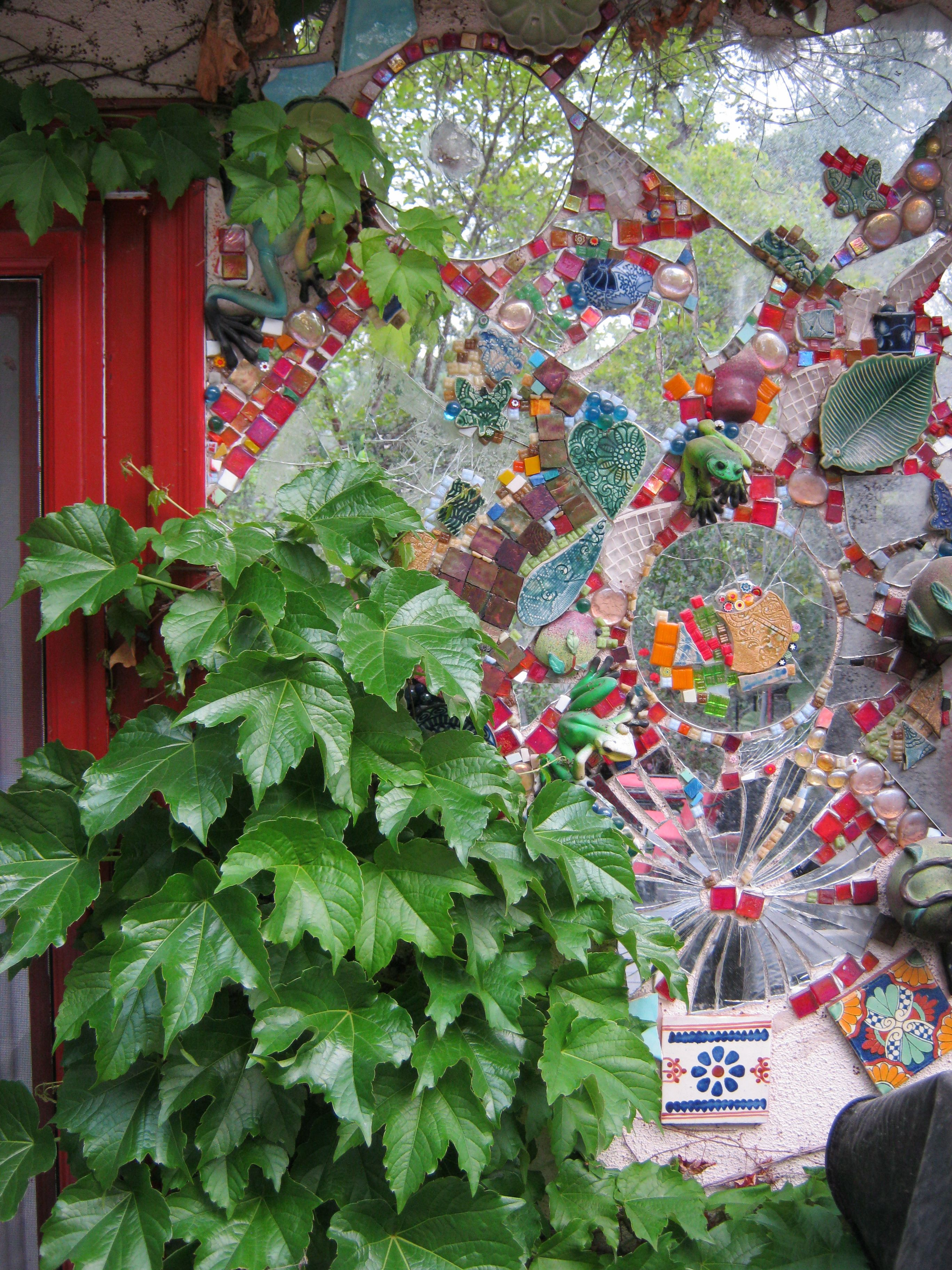 Mosaic and ivy on a garden wall mosaics pinterest for Garden wall mosaic designs
